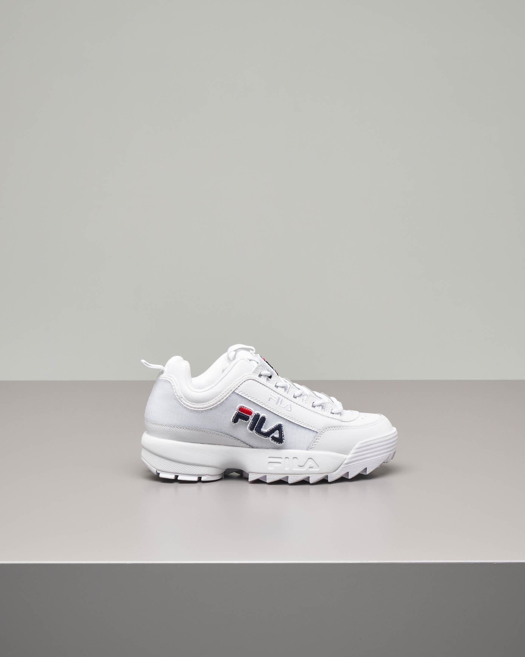 Sneaker Fila Disruptor bianca con patches