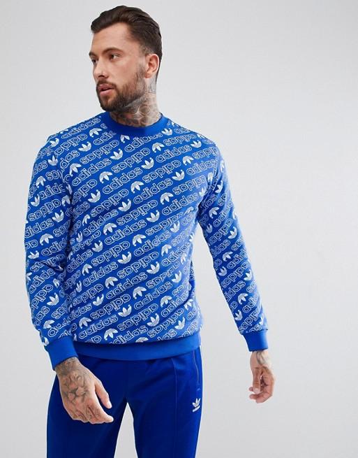 Adidas Originals - Felpa blu con stampa su tutta la superficie CV8600