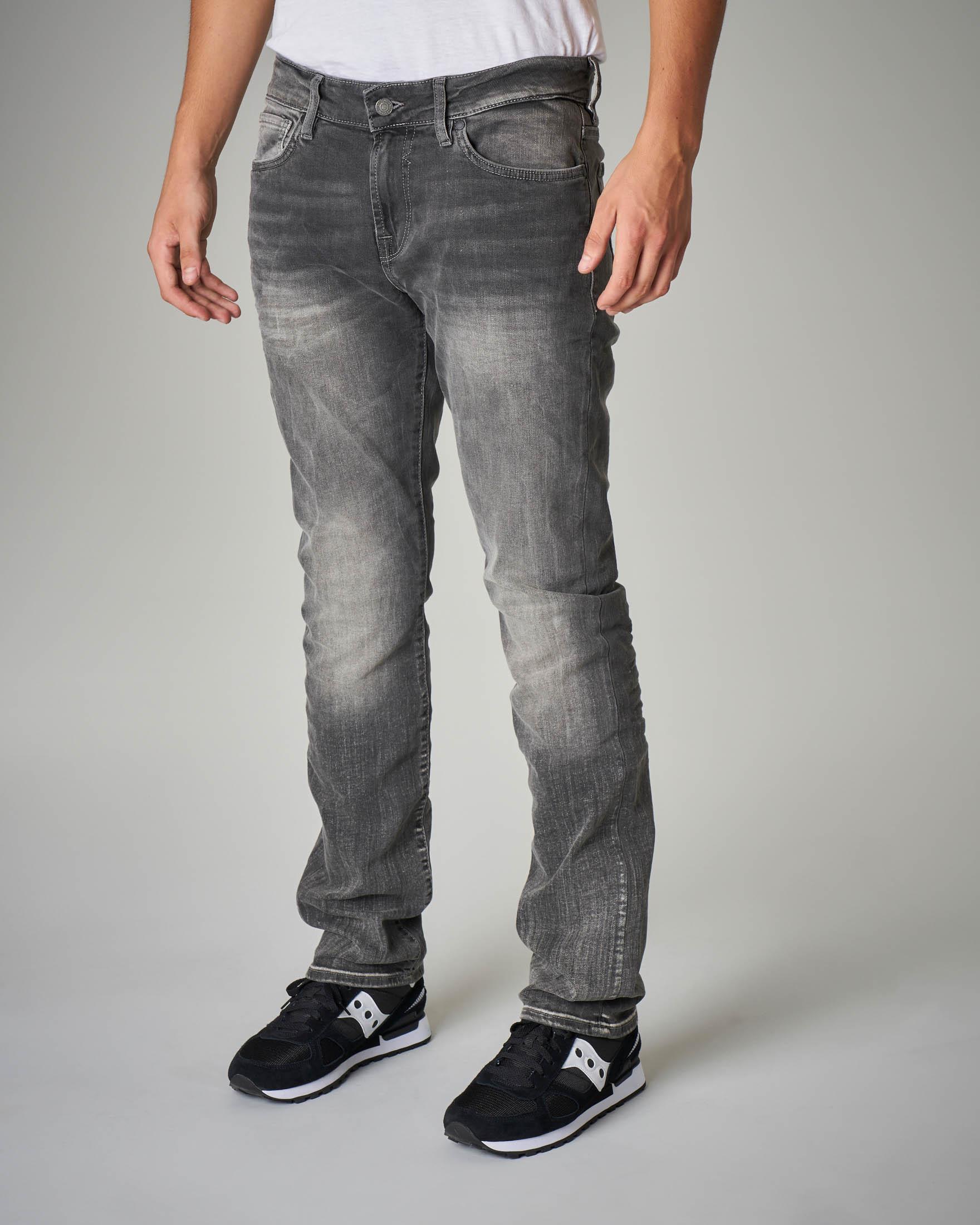 Jeans skinny grigio con sbiancature