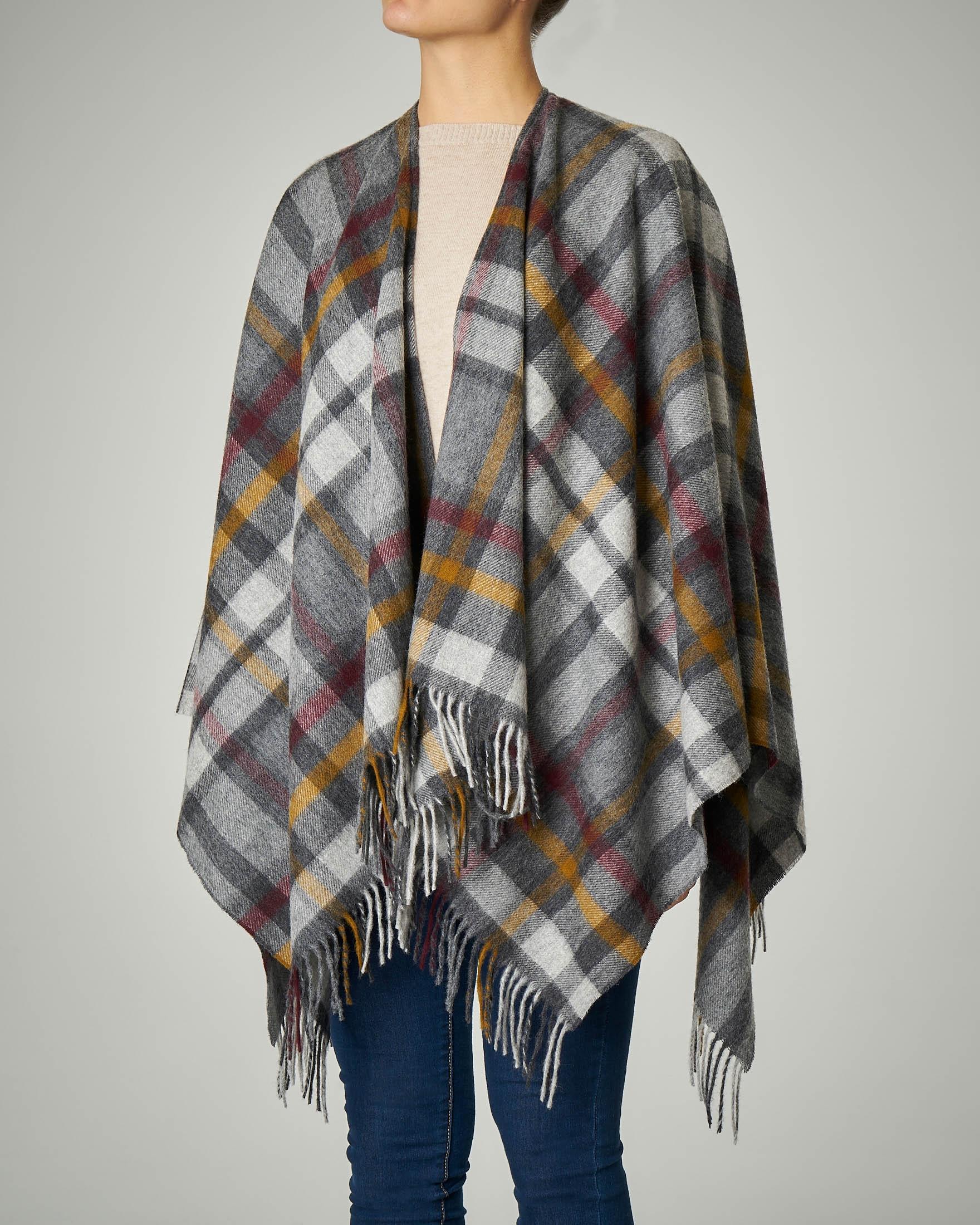 Poncho in lana merino a fantasia tartan grigio con frange