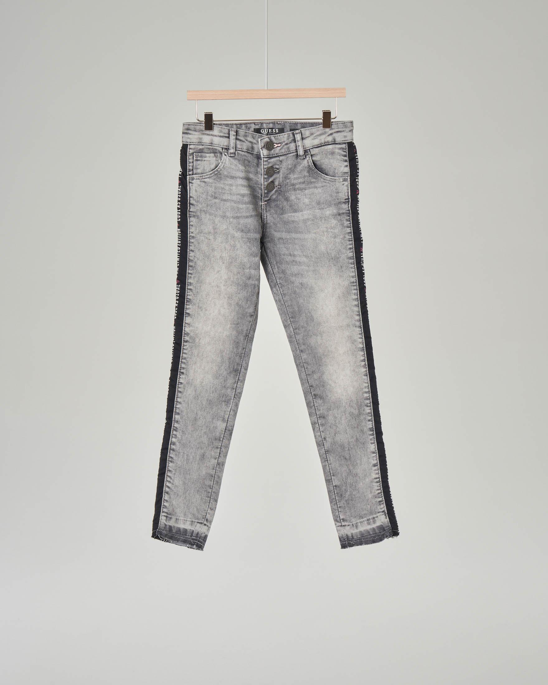 Jeans neri effetto slavato con fascia laterale