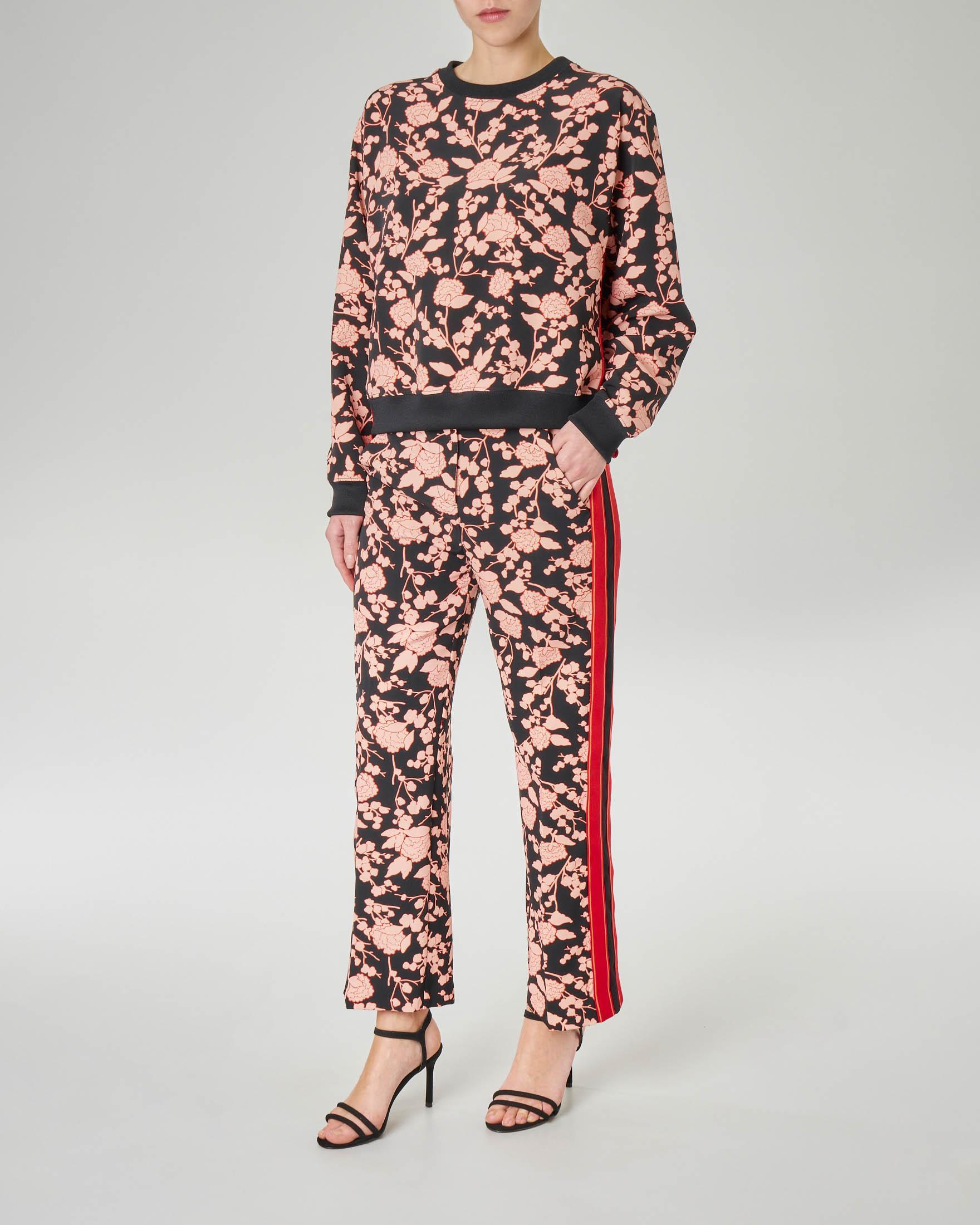 Pantalone nero dritto alla caviglia a fantasia floreale in tessuto tecnico