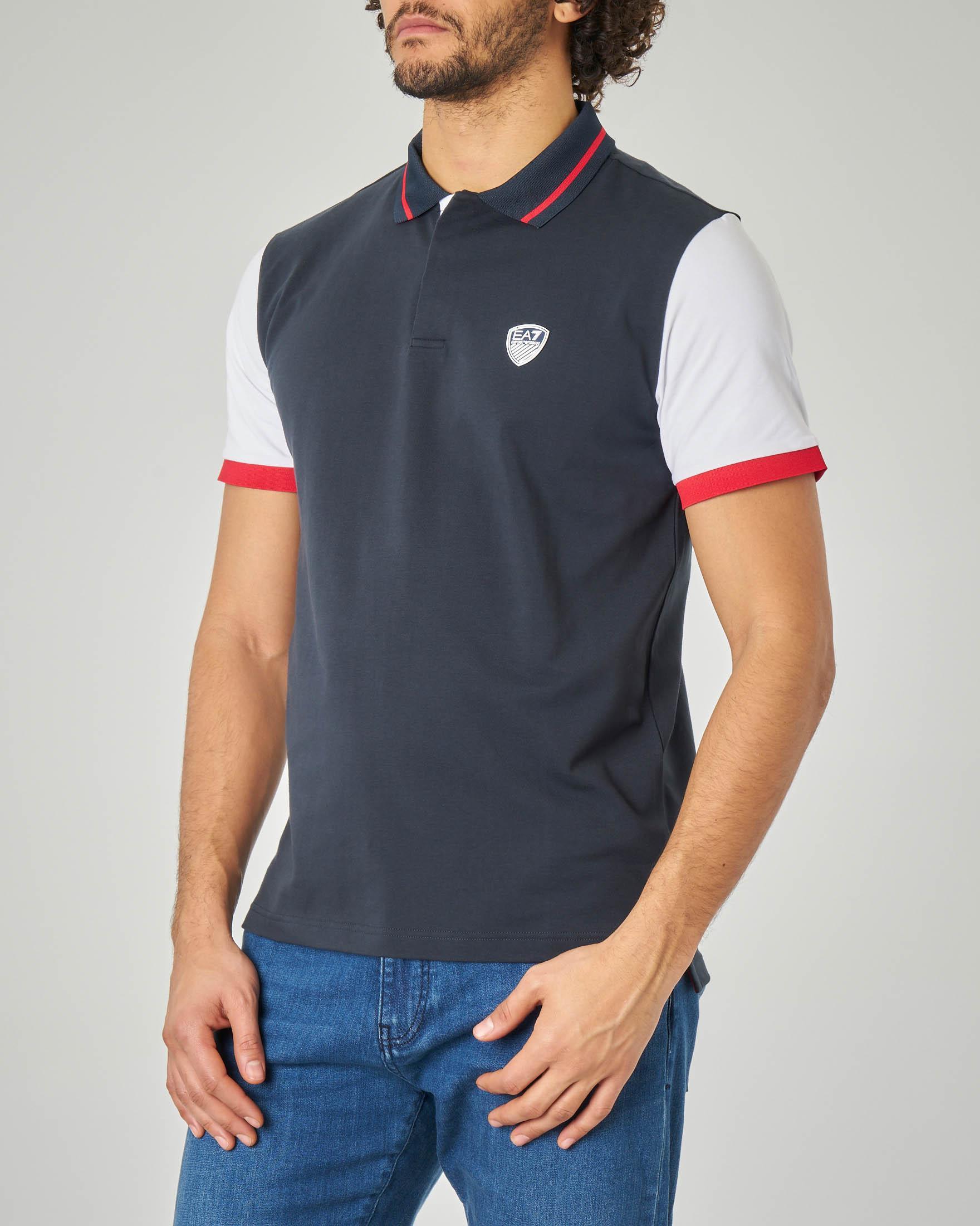 Polo blu in jersey stretch con maniche e bordino in contrasto