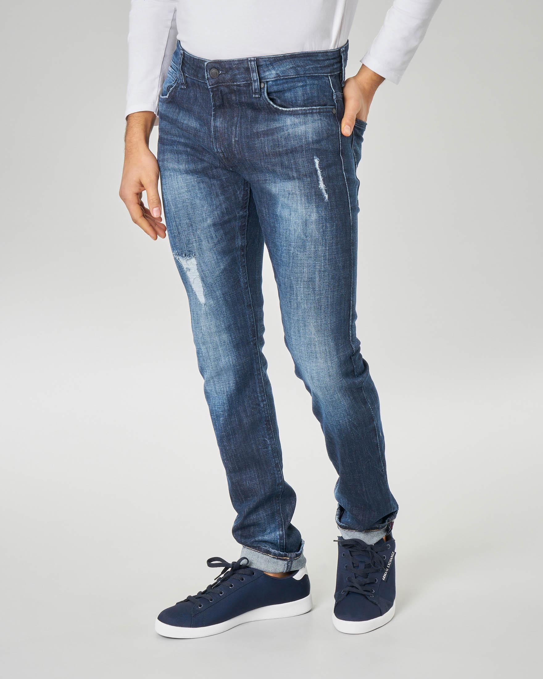 Jeans super skinny con abrasioni