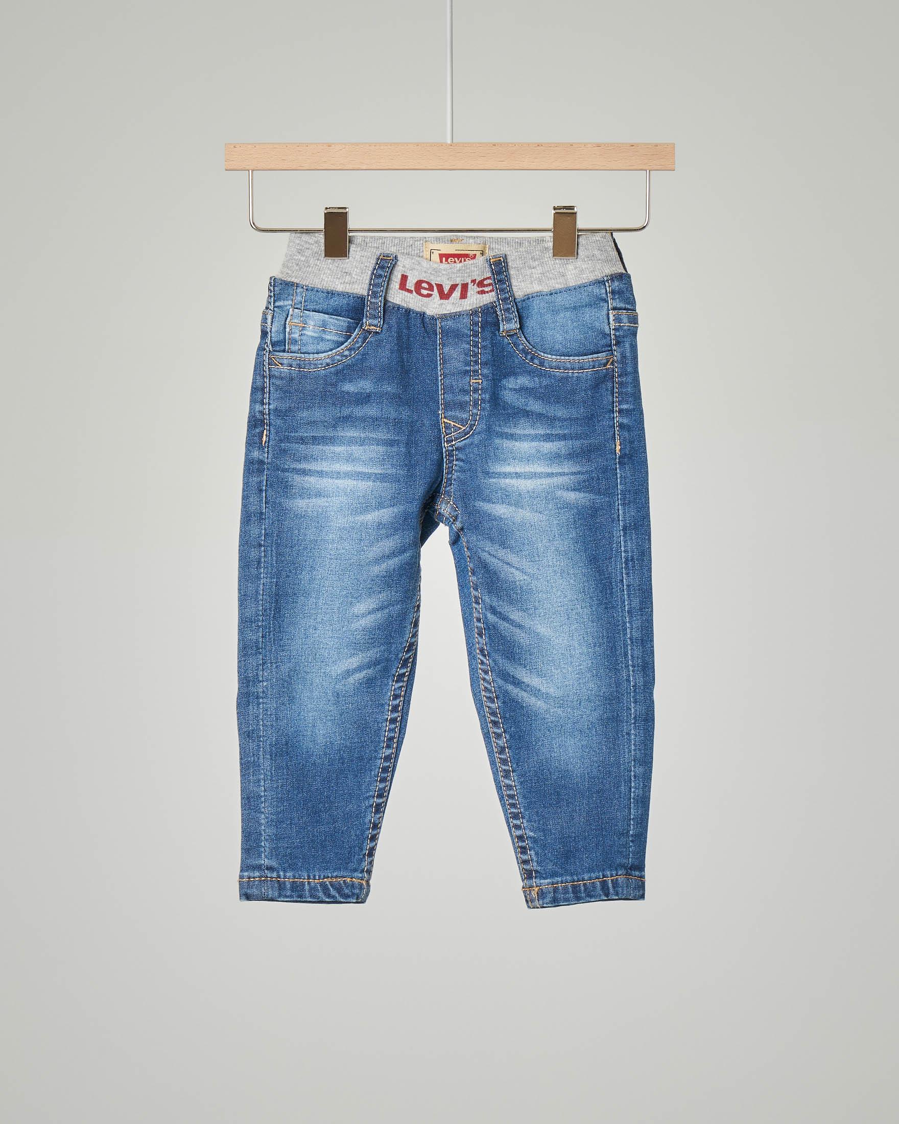 Jeans con elastico in vita logato