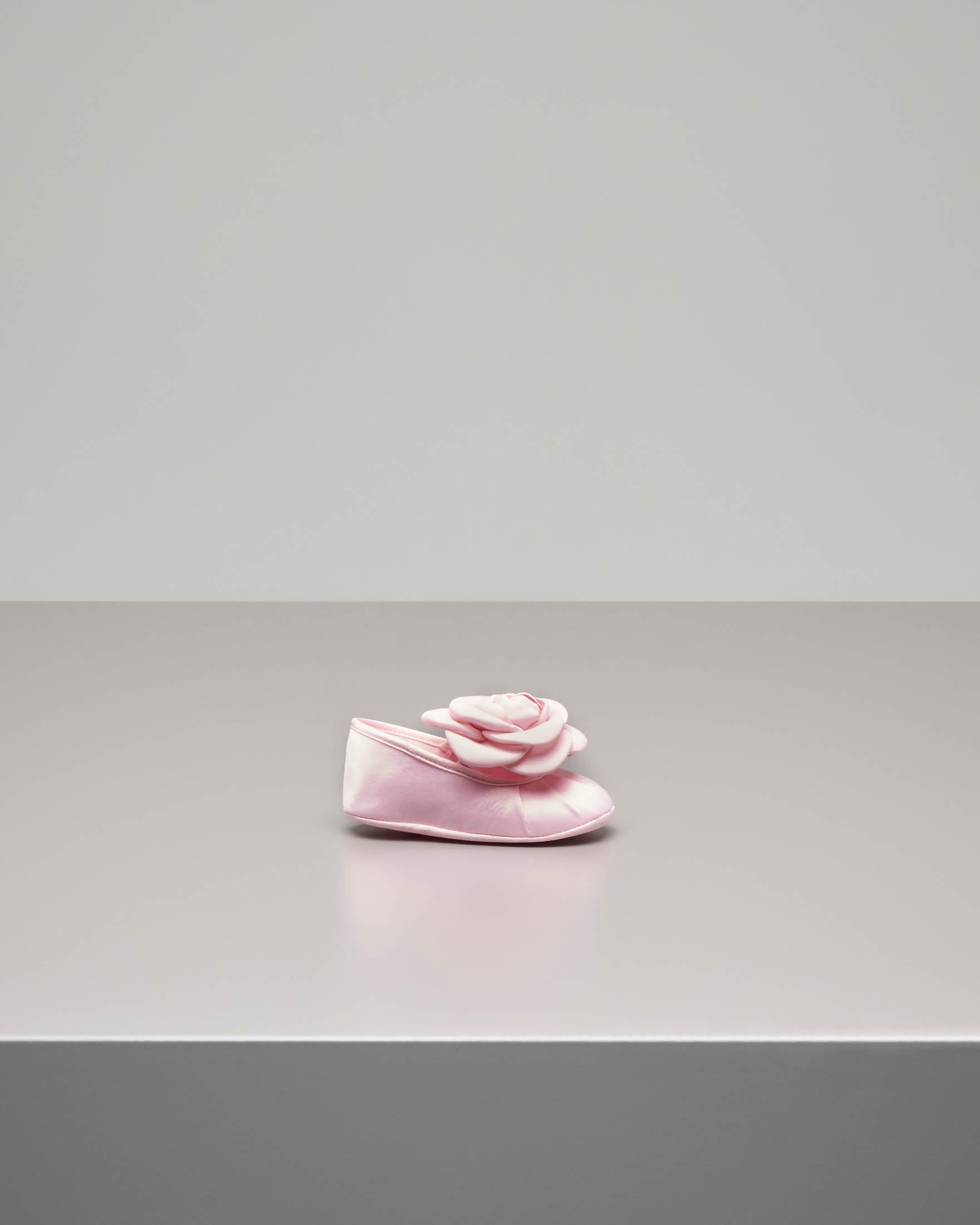 Ballerina rosa con fiore
