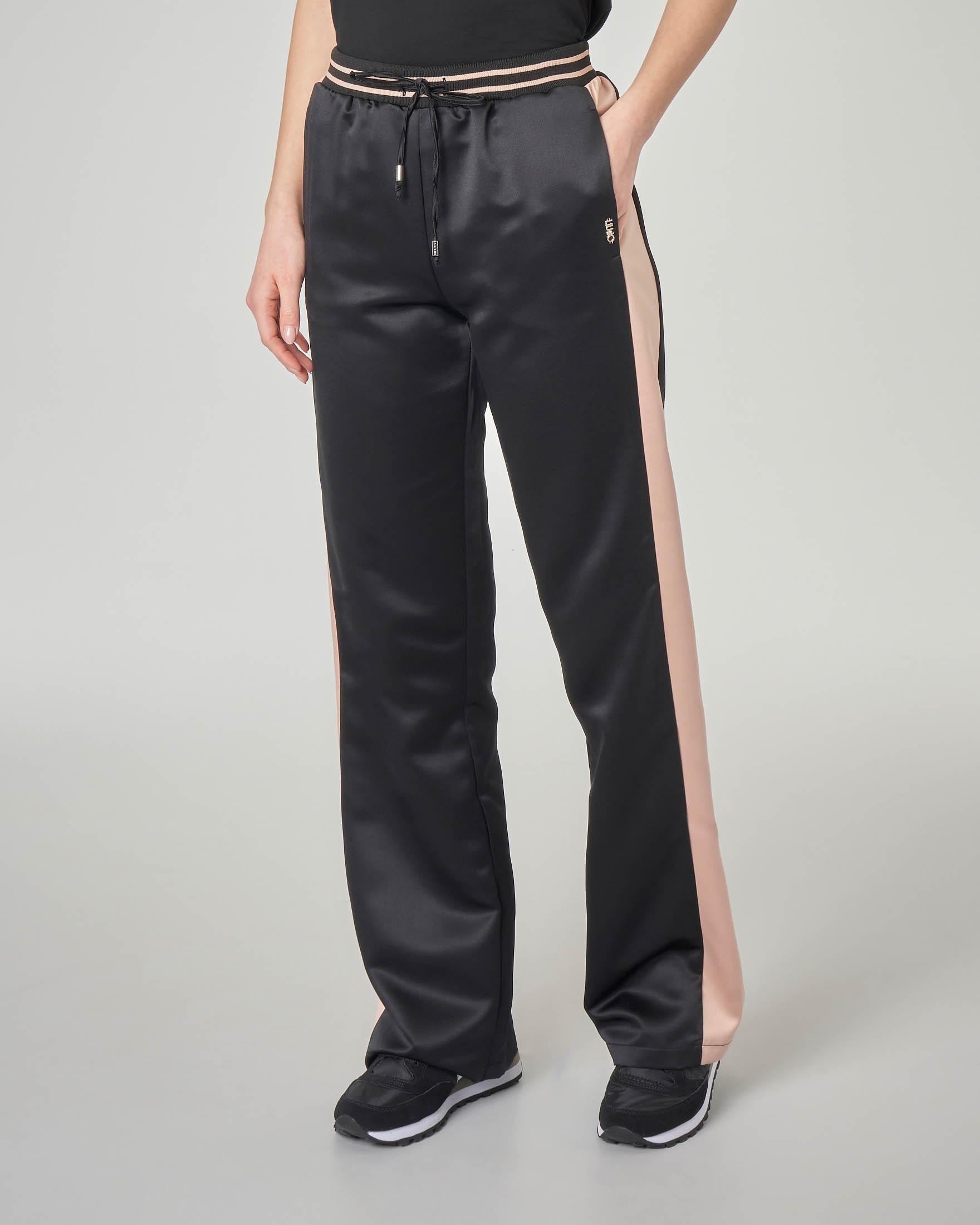 Pantaloni joggers neri con fascia laterale rosa