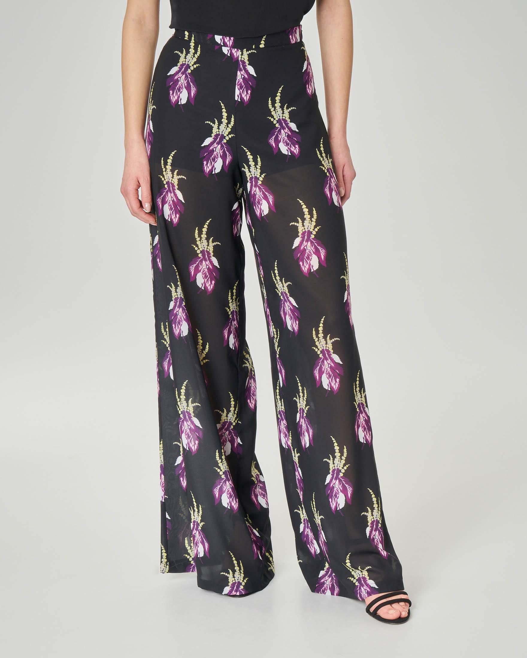Pantaloni palazzo neri in georgette effetto trasparente con stampa floreale