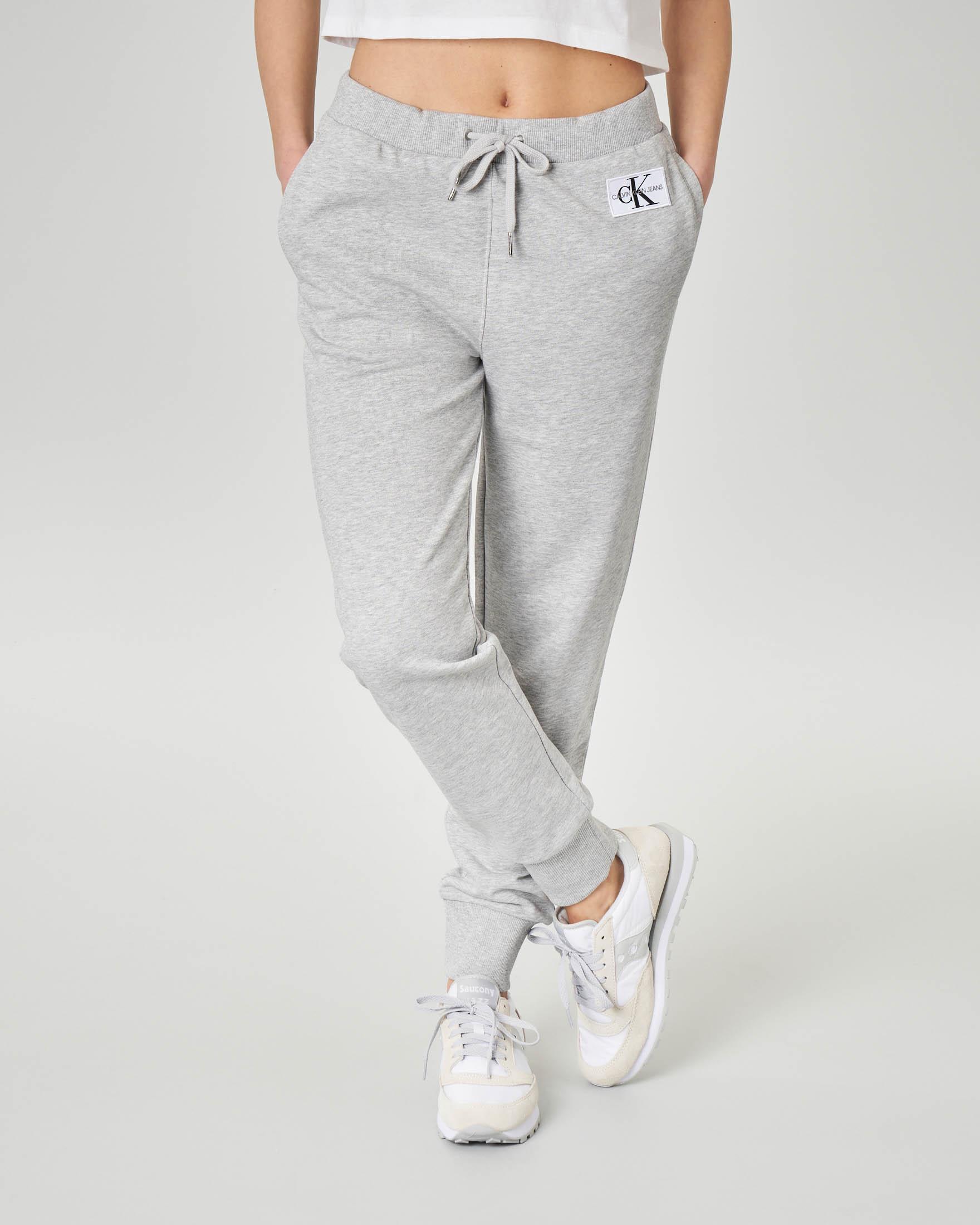 Pantaloni in felpa grigi con polsini a costine