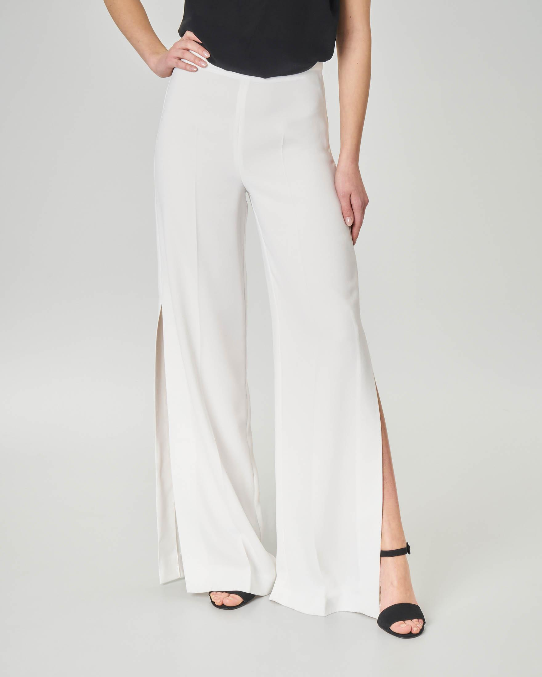Pantaloni in cady bianchi con spacco laterale