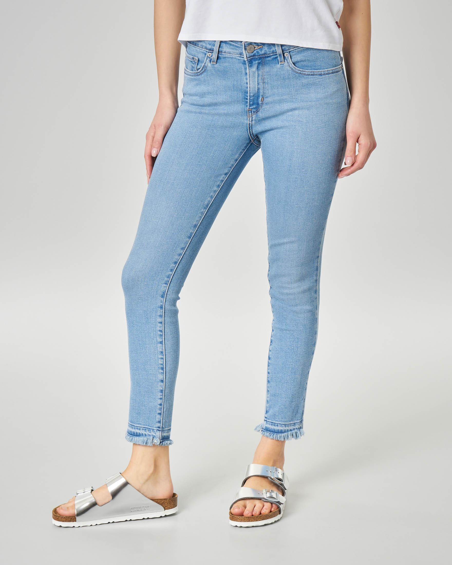 Jeans 711 skinny blu super stone washed con orli sfrangiati