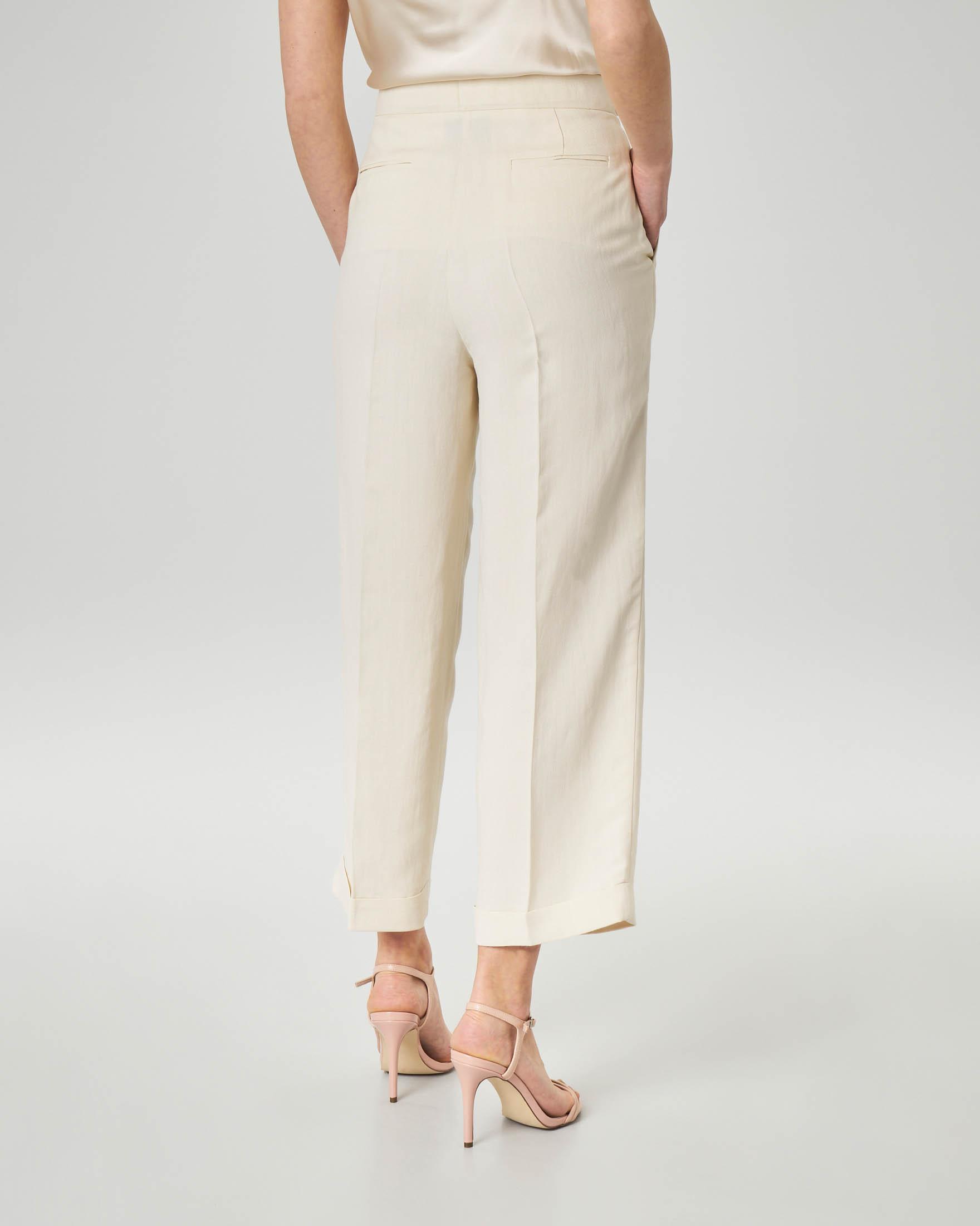 Pantaloni in lino color avorio con risvolto