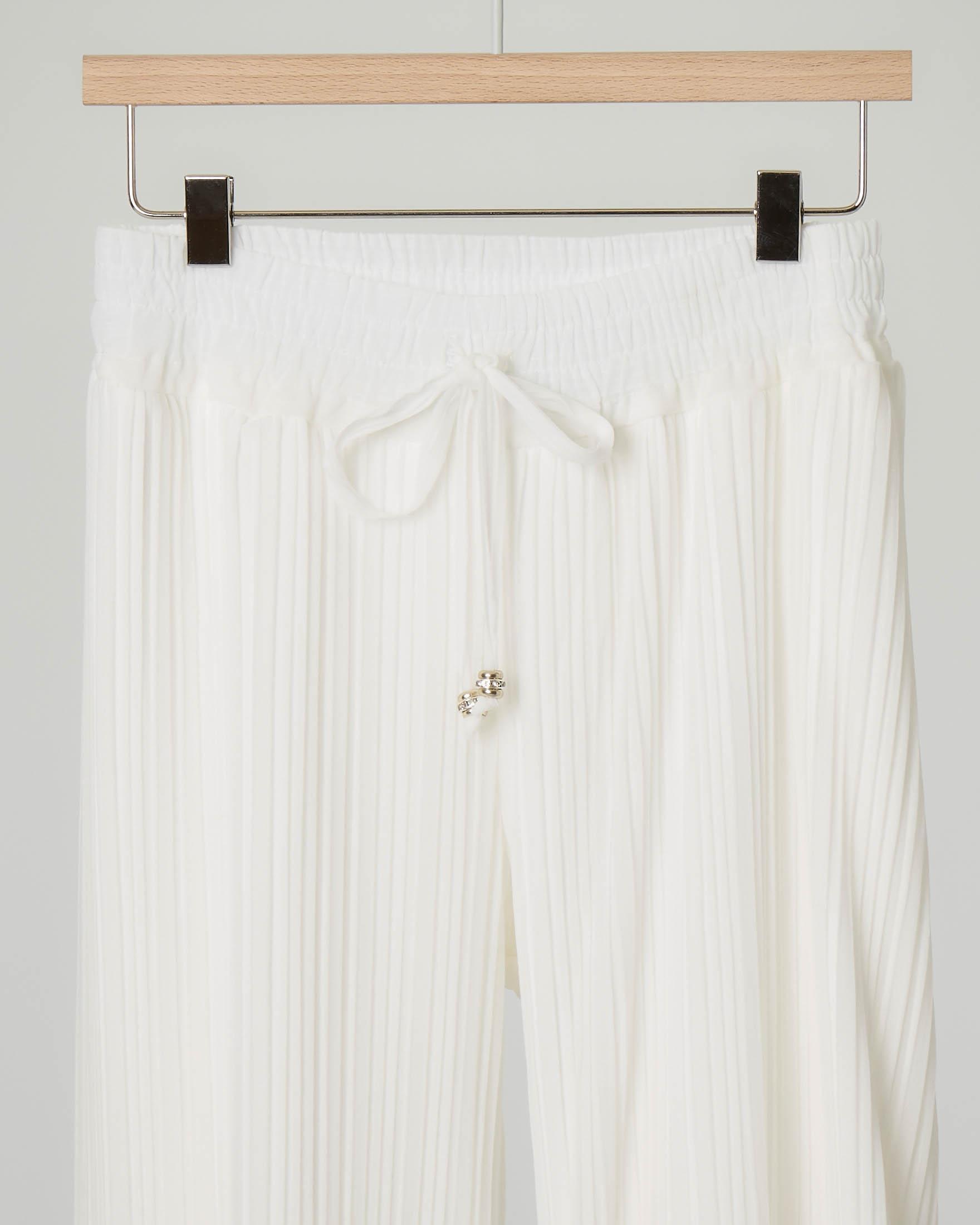 Pantalone palazzo plissè color avorio