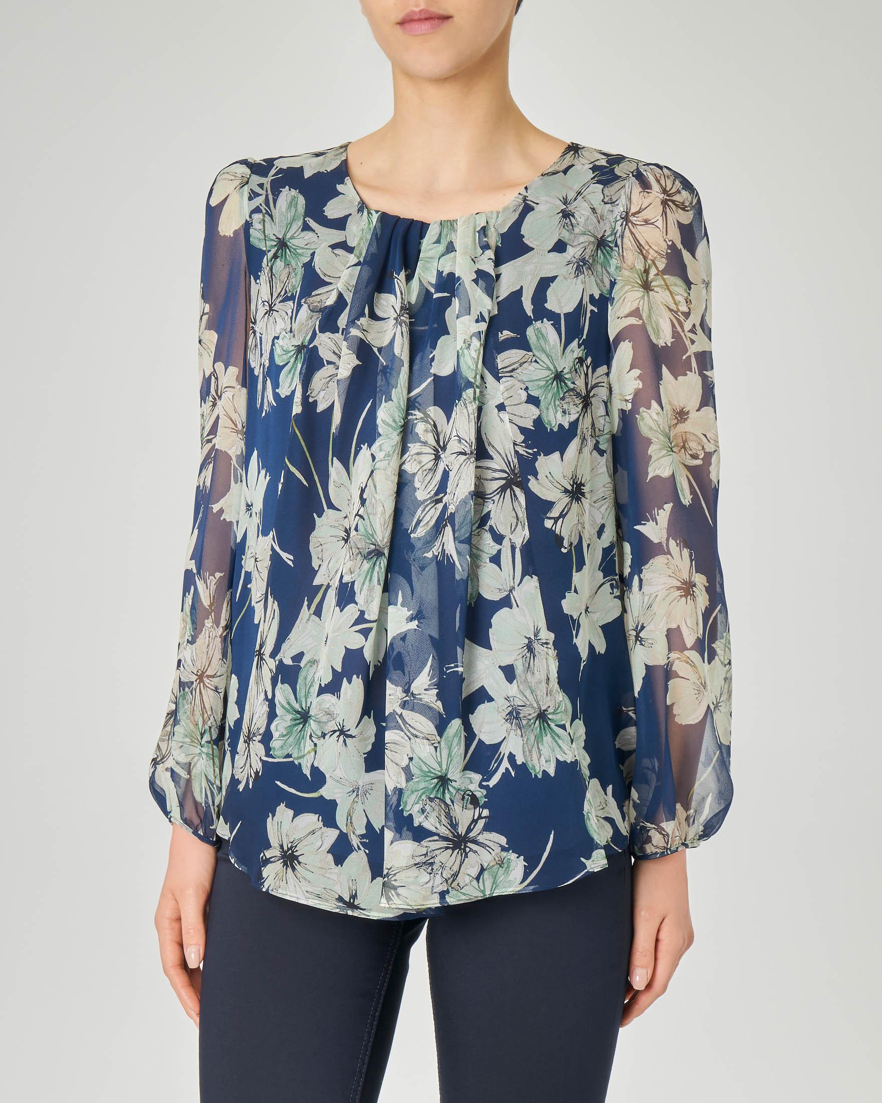 Blusa in seta blu a stampa floreale con maniche lunghe a palloncino