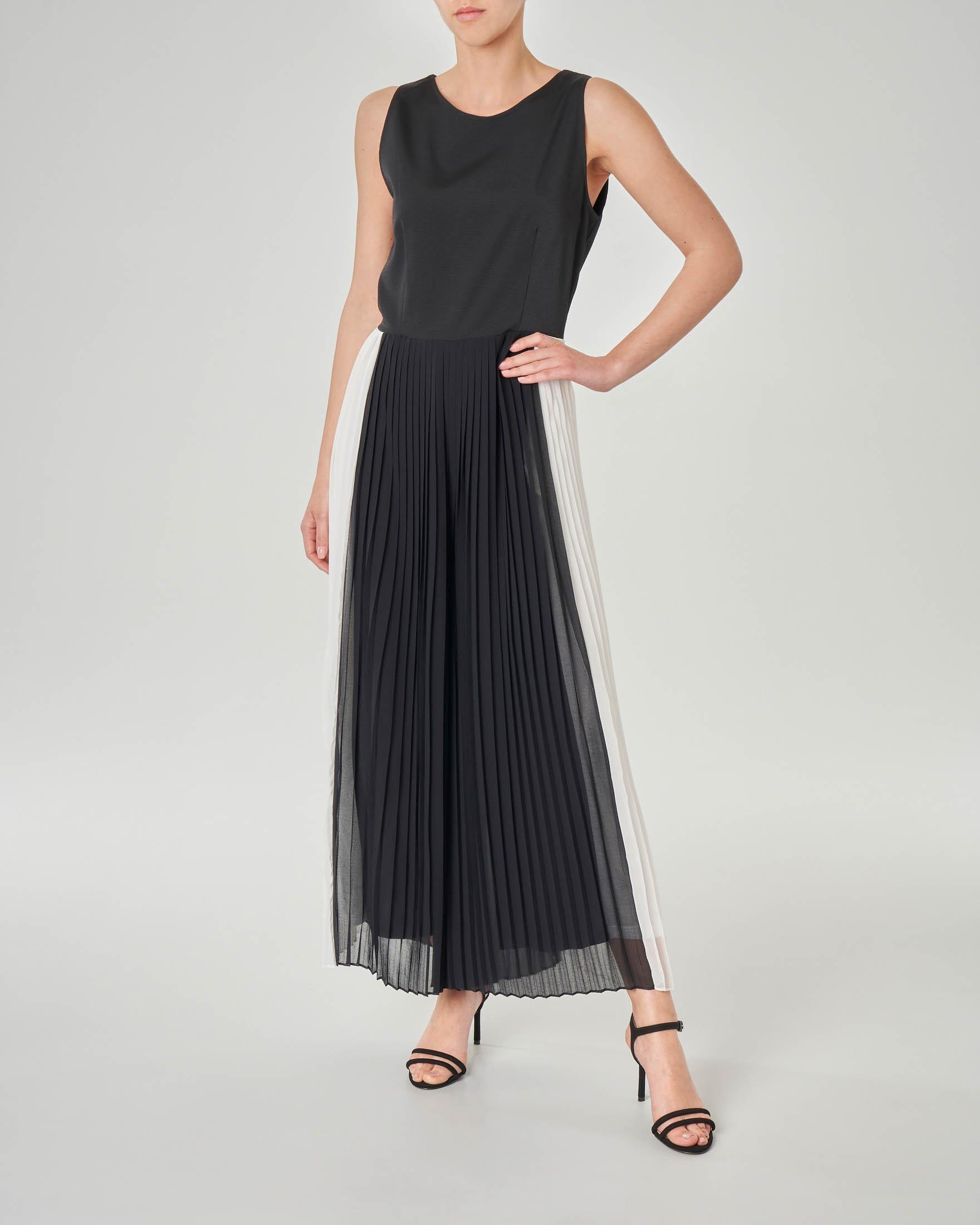 Tuta con pantalone plissè bicolore e corpetto con apertura sulla schiena