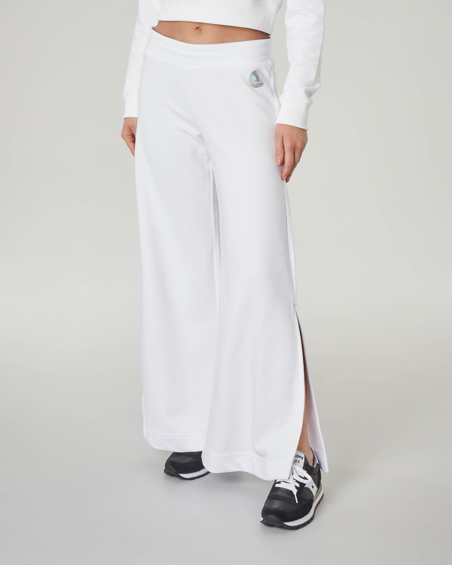 Pantaloni bianchi in felpa con spacchi laterali