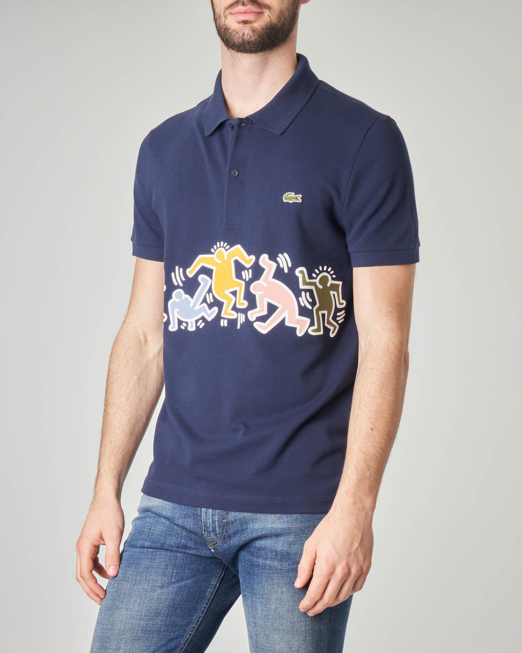 Polo blu con stampa Keith Haring davanti