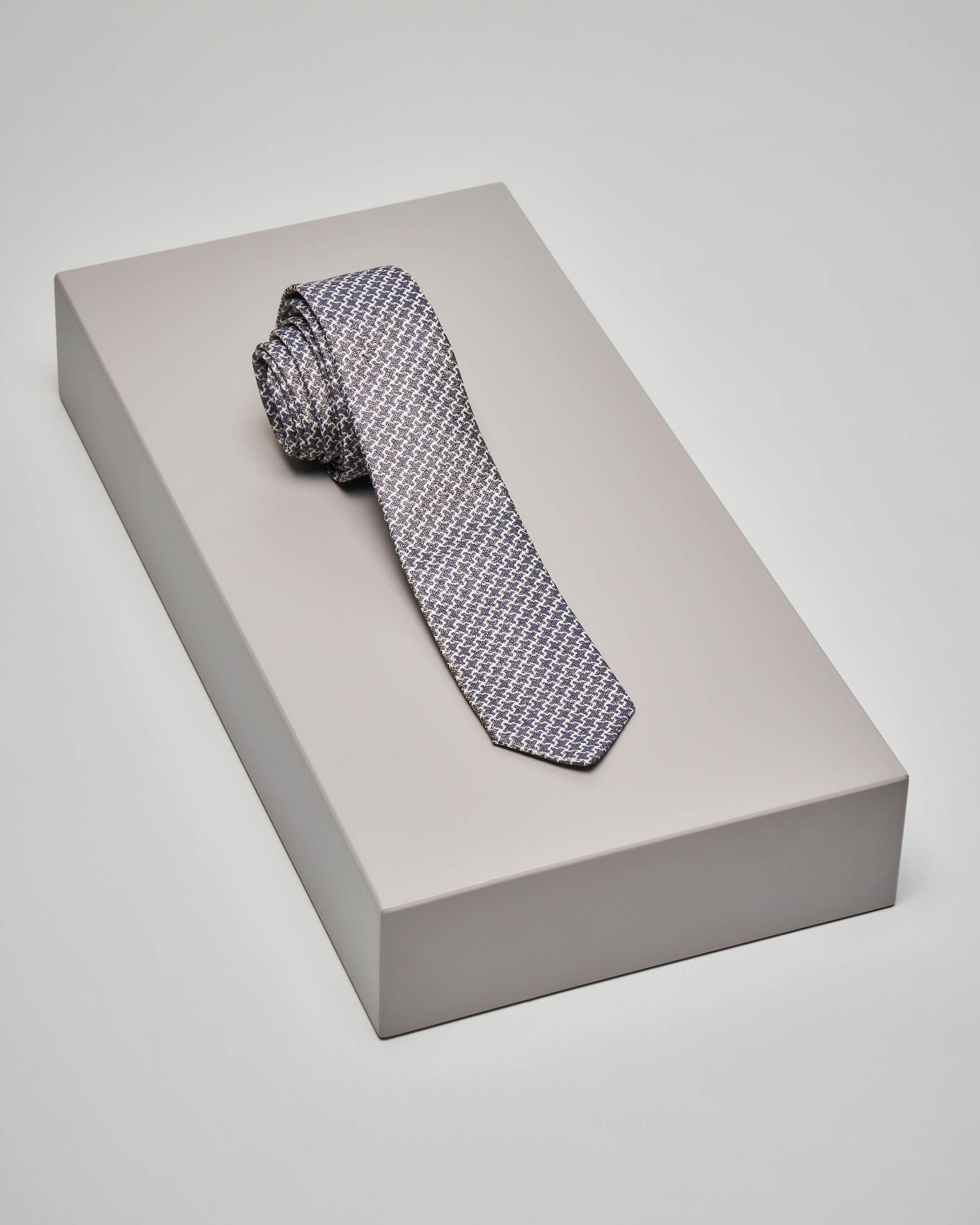 Cravatta grigio-blu con fantasia bianca