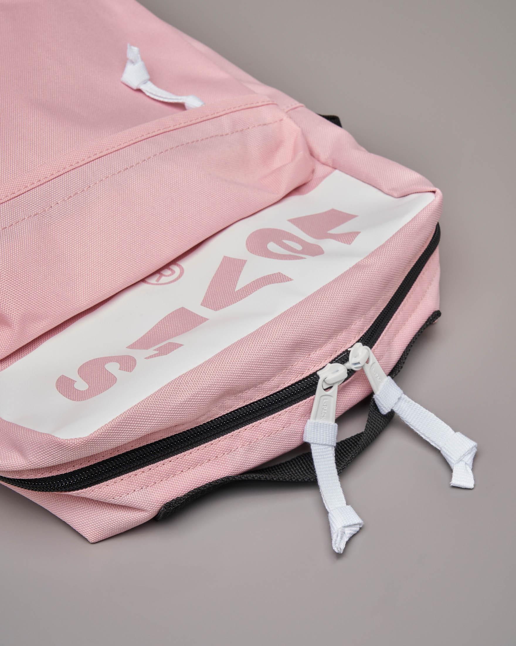 Zaino rosa quadrato con ampia tasca frontale e scritta logo a contrasto