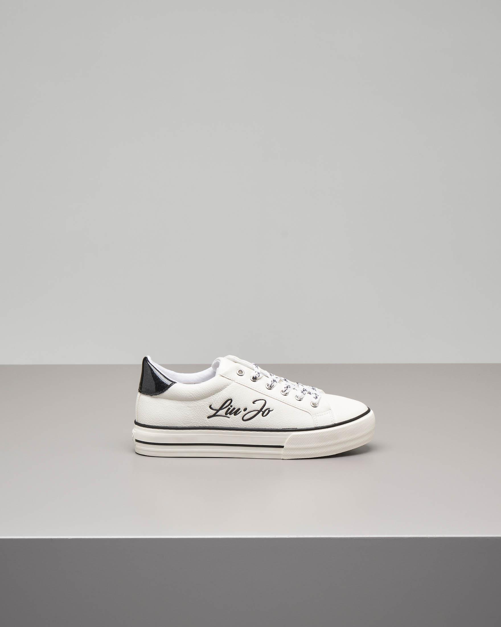 Sneakers bianca e nera para alta