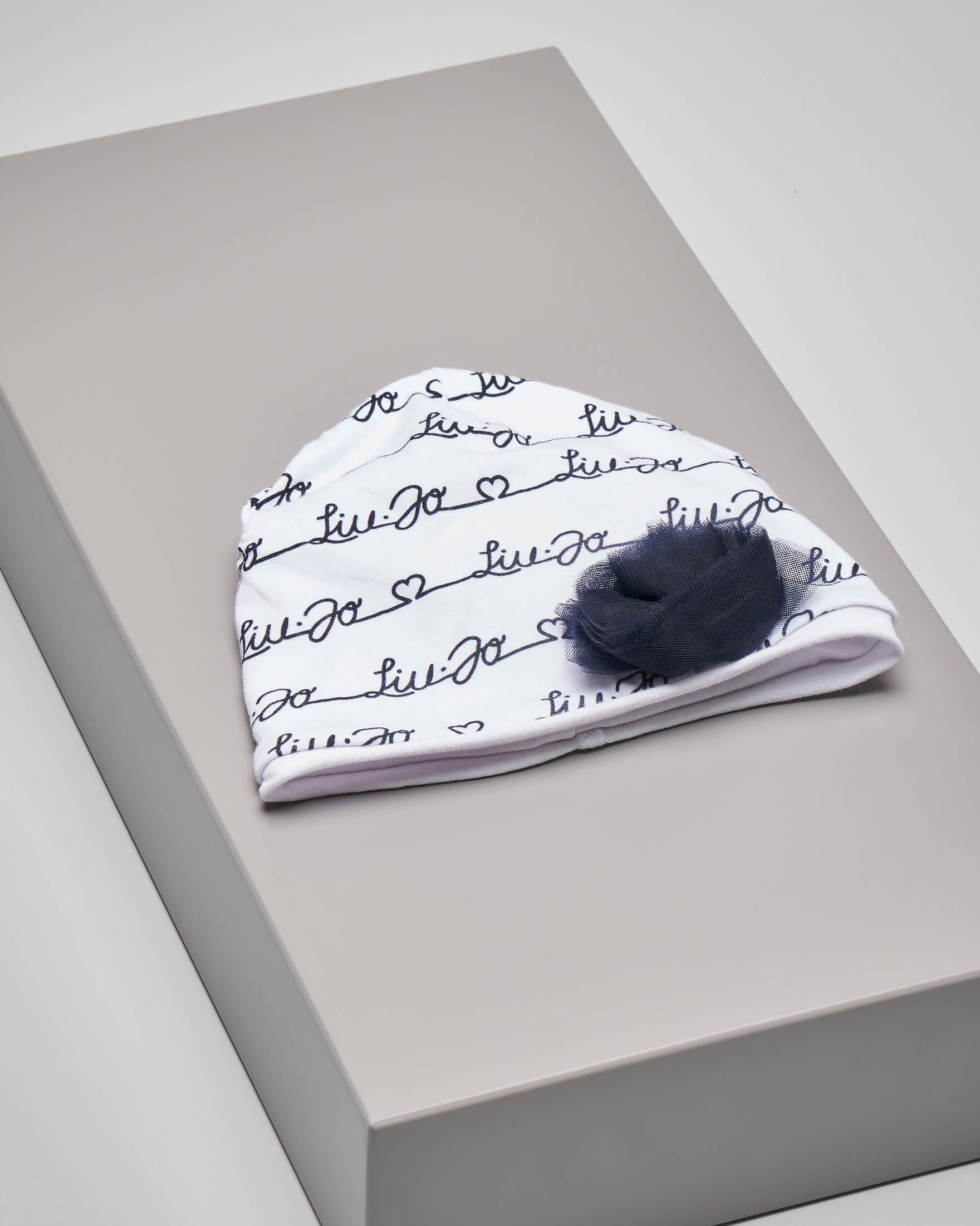 Cuffietta bianca in cotone elasticizzato con scritta logo blu e bocciolo in tulle