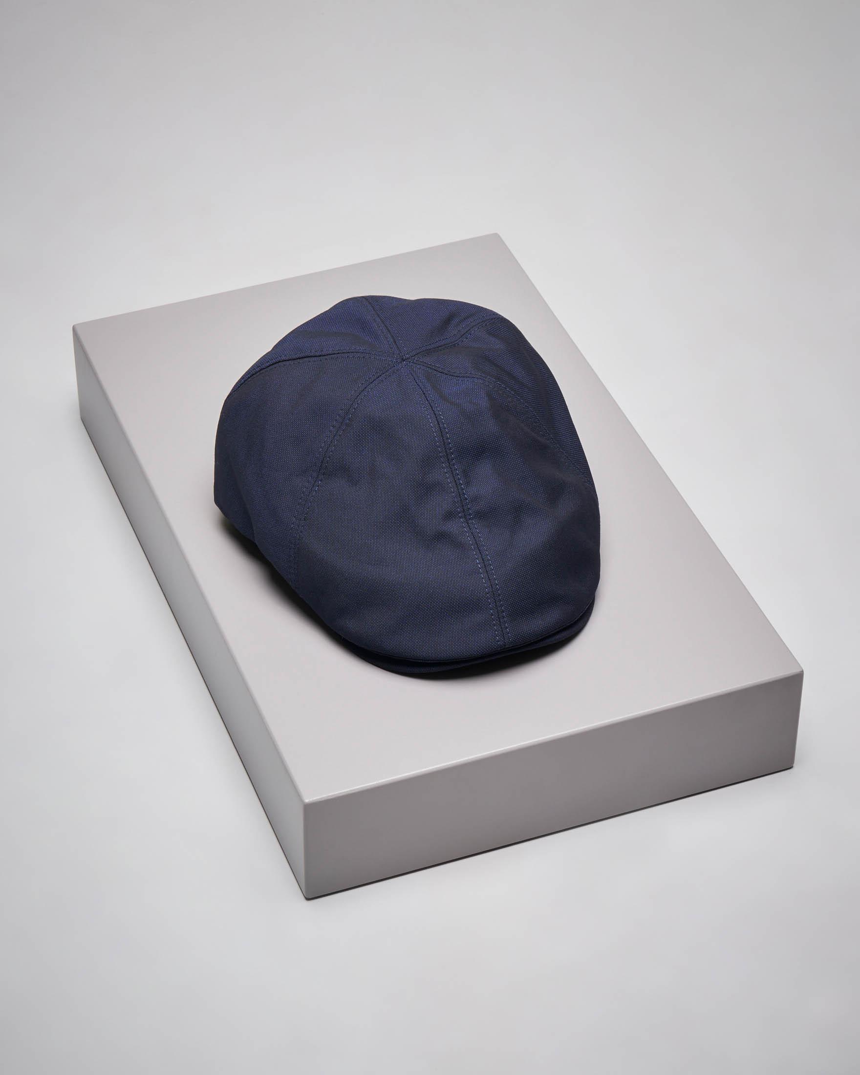 Coppola blu con logo