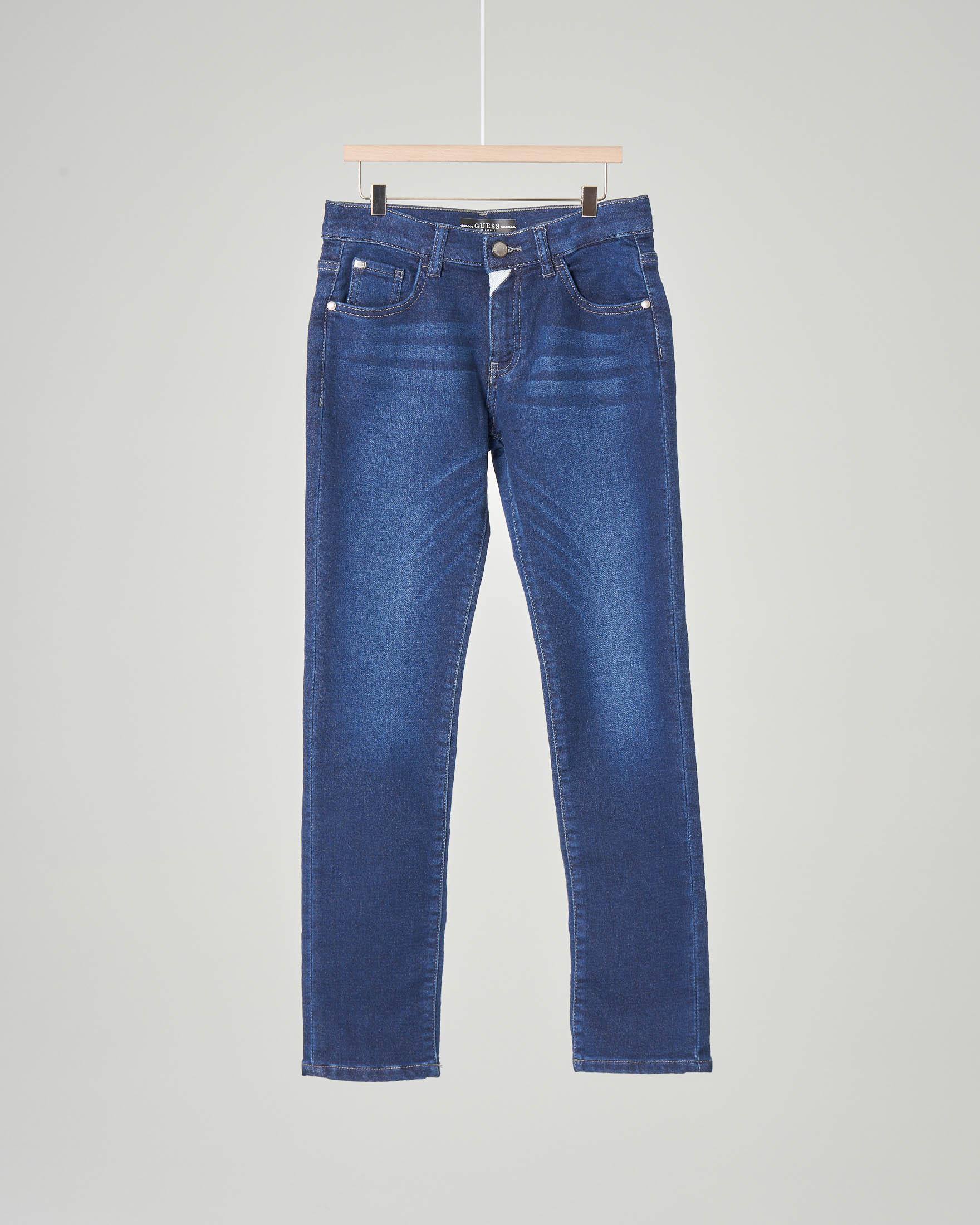 Jeans lavaggio medio con baffature 8-16 anni