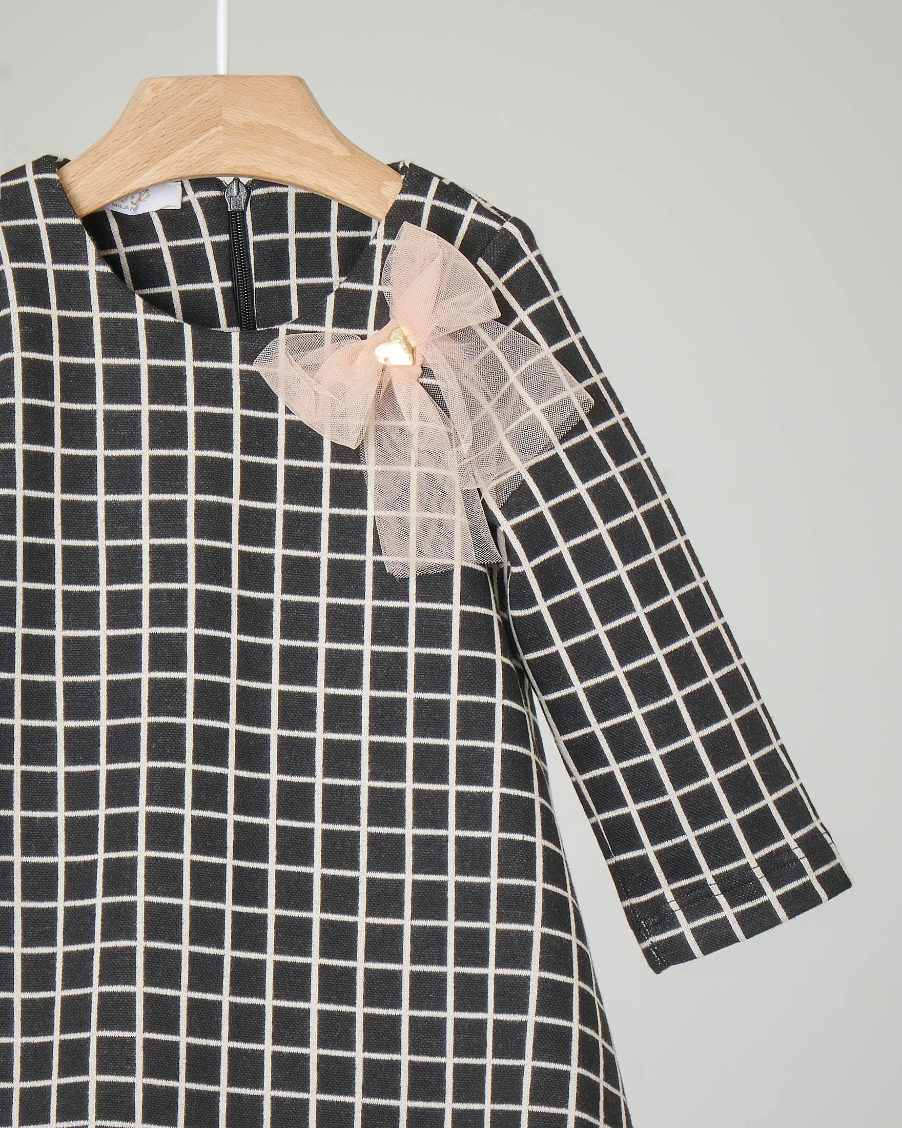 Abito nero in jersey con quadri bianchi e fiocco rosa 9-18 mesi
