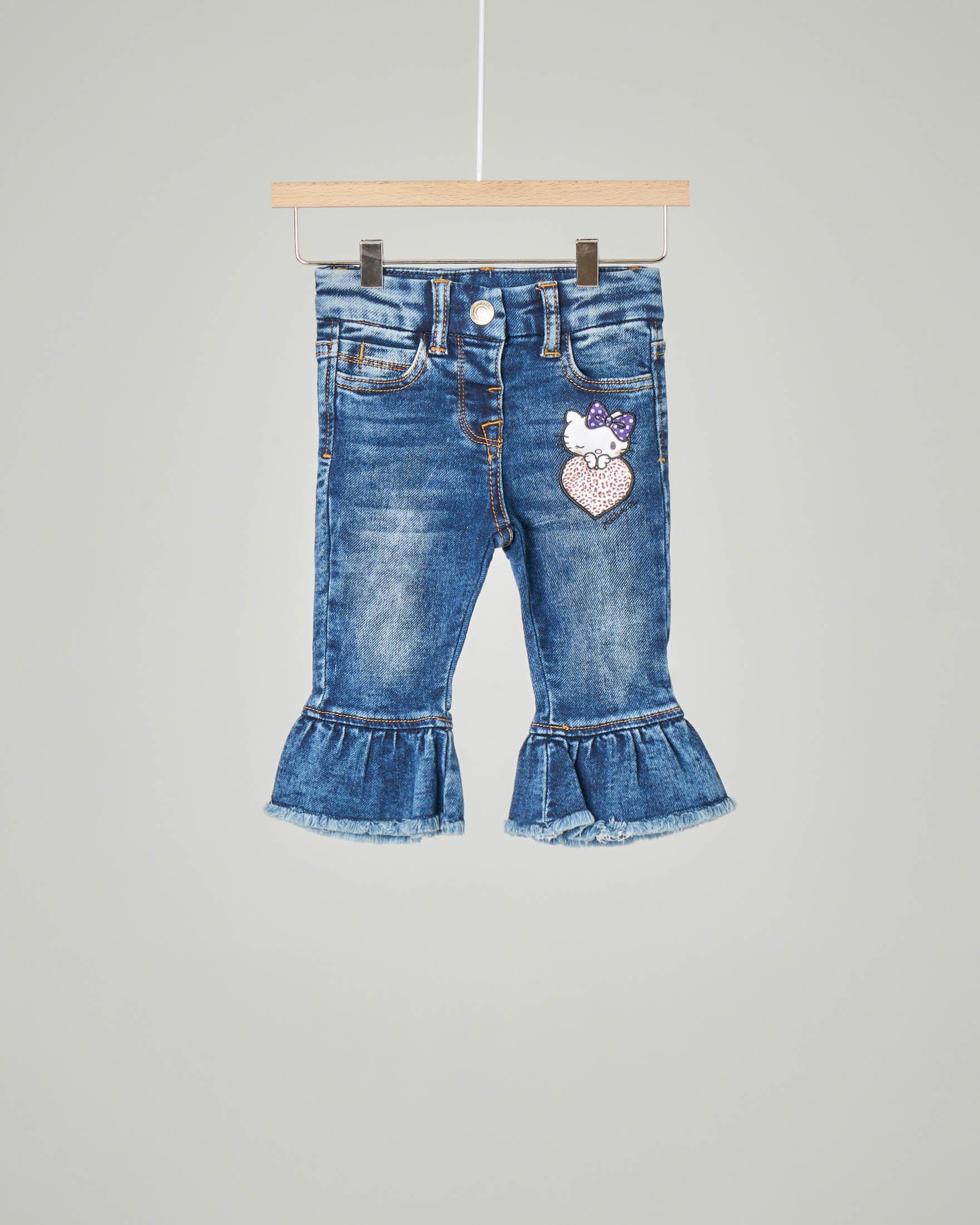 Jeans con patch Hello Kitty e volant sul fondo 12-36 mesi