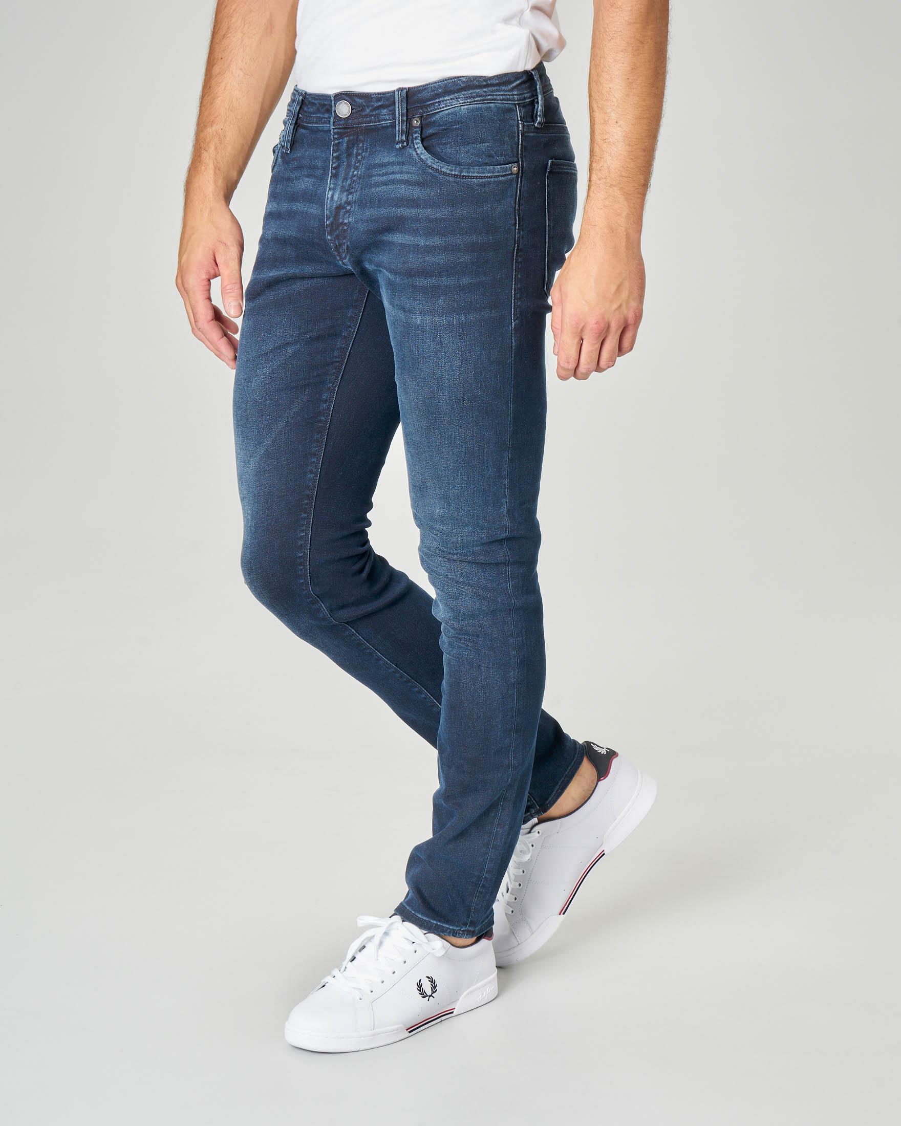 Jeans Glenn lavaggio blu scuro con baffature e vestibilità slim