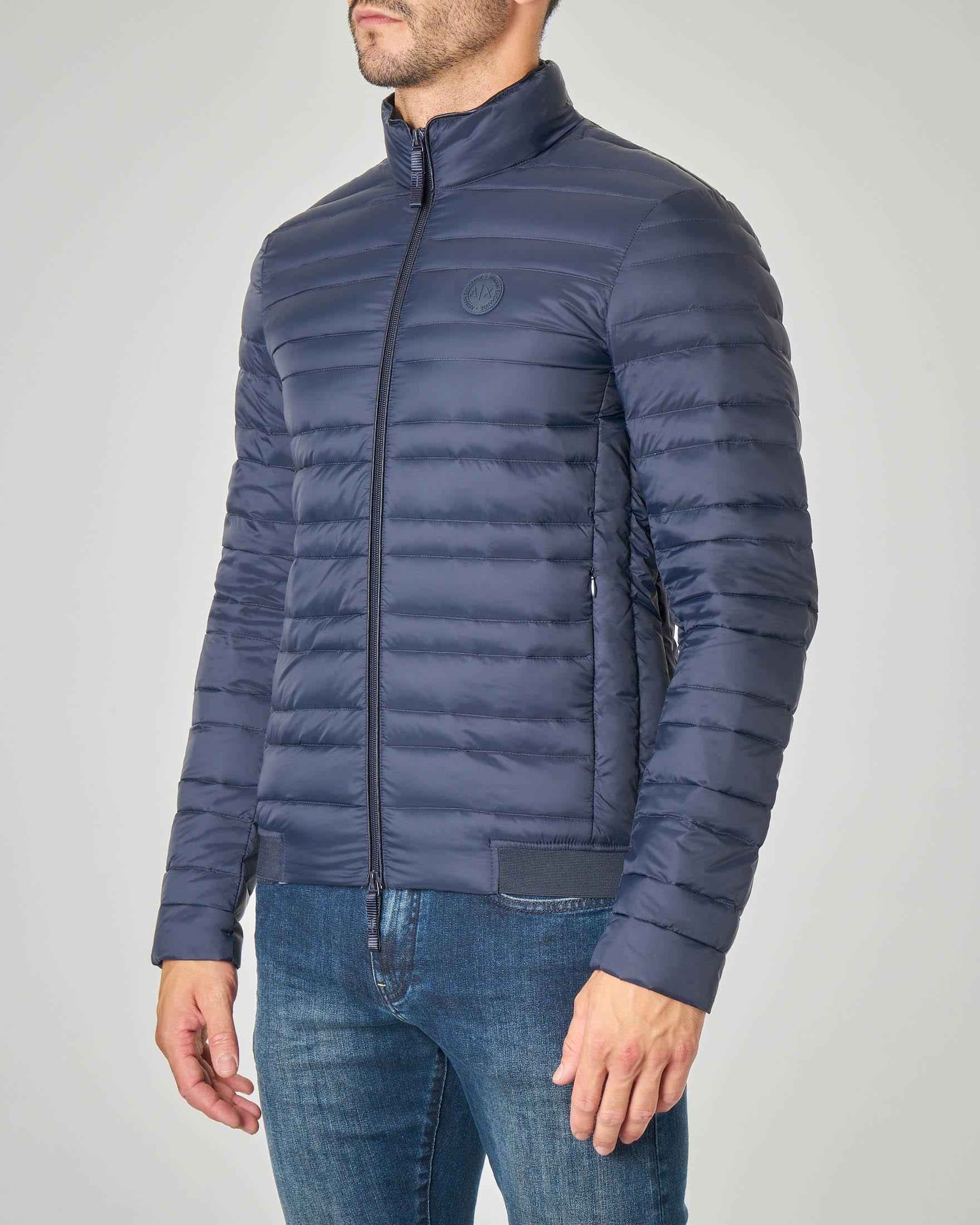 Piumino blu senza cappuccio con elastico logato in vita