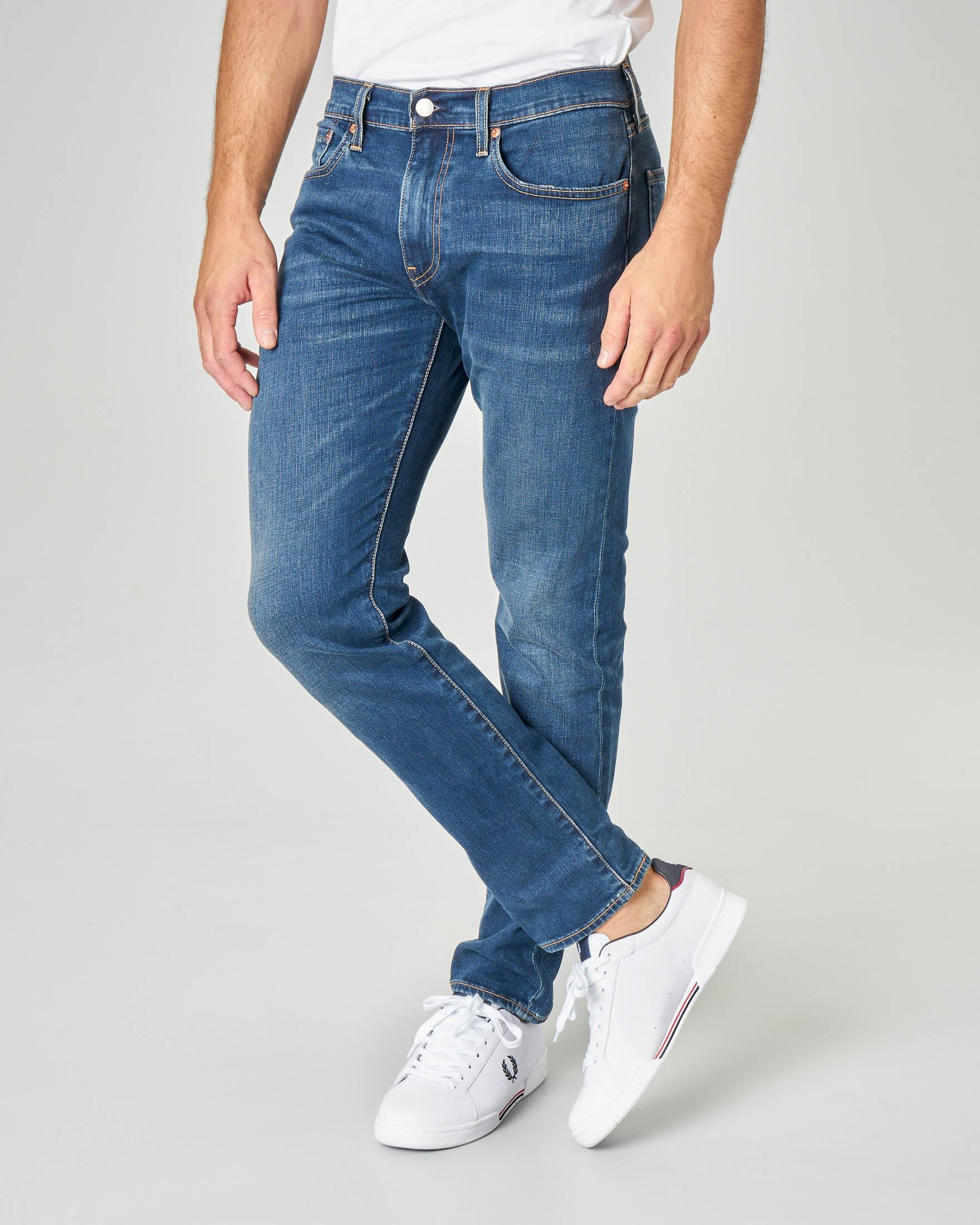 Jeans 502 regular lavaggio blu scuro con baffature