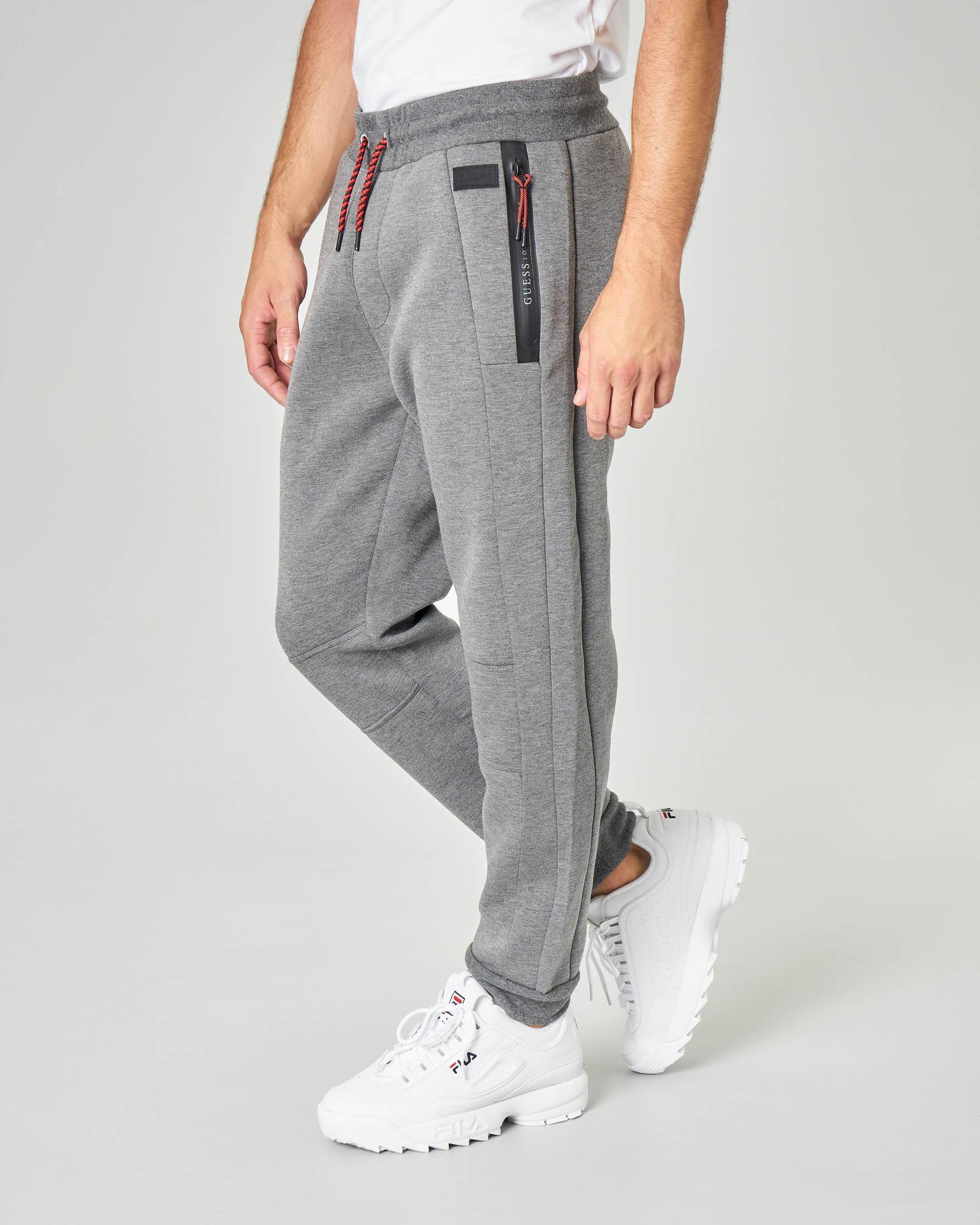 Pantalone grigio in felpa con zip termonastrate