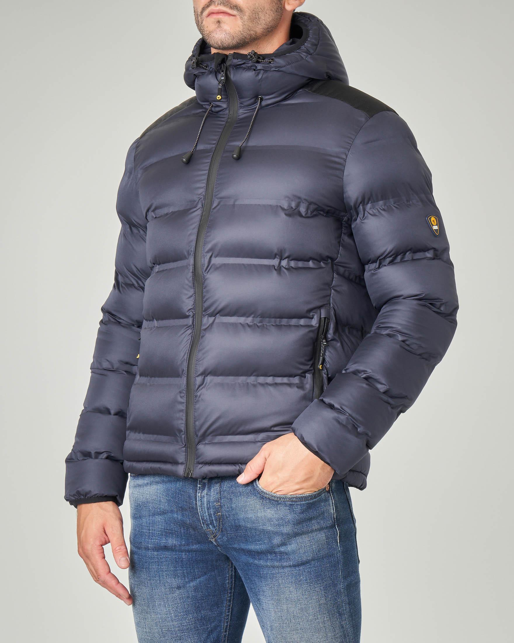 Piumino blu con cappuccio e inserto sulle spalle in cordura