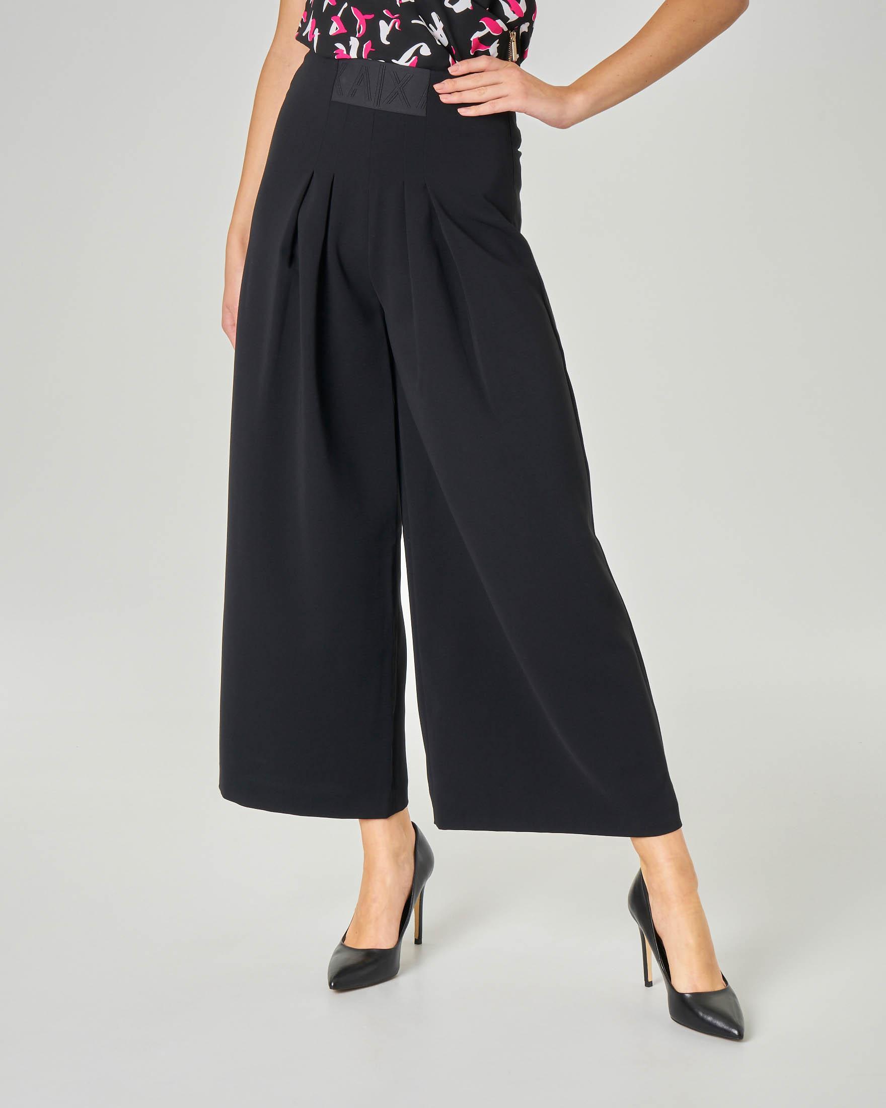 Pantaloni culotte con doppia pince in vita ed elastico con scritta logo