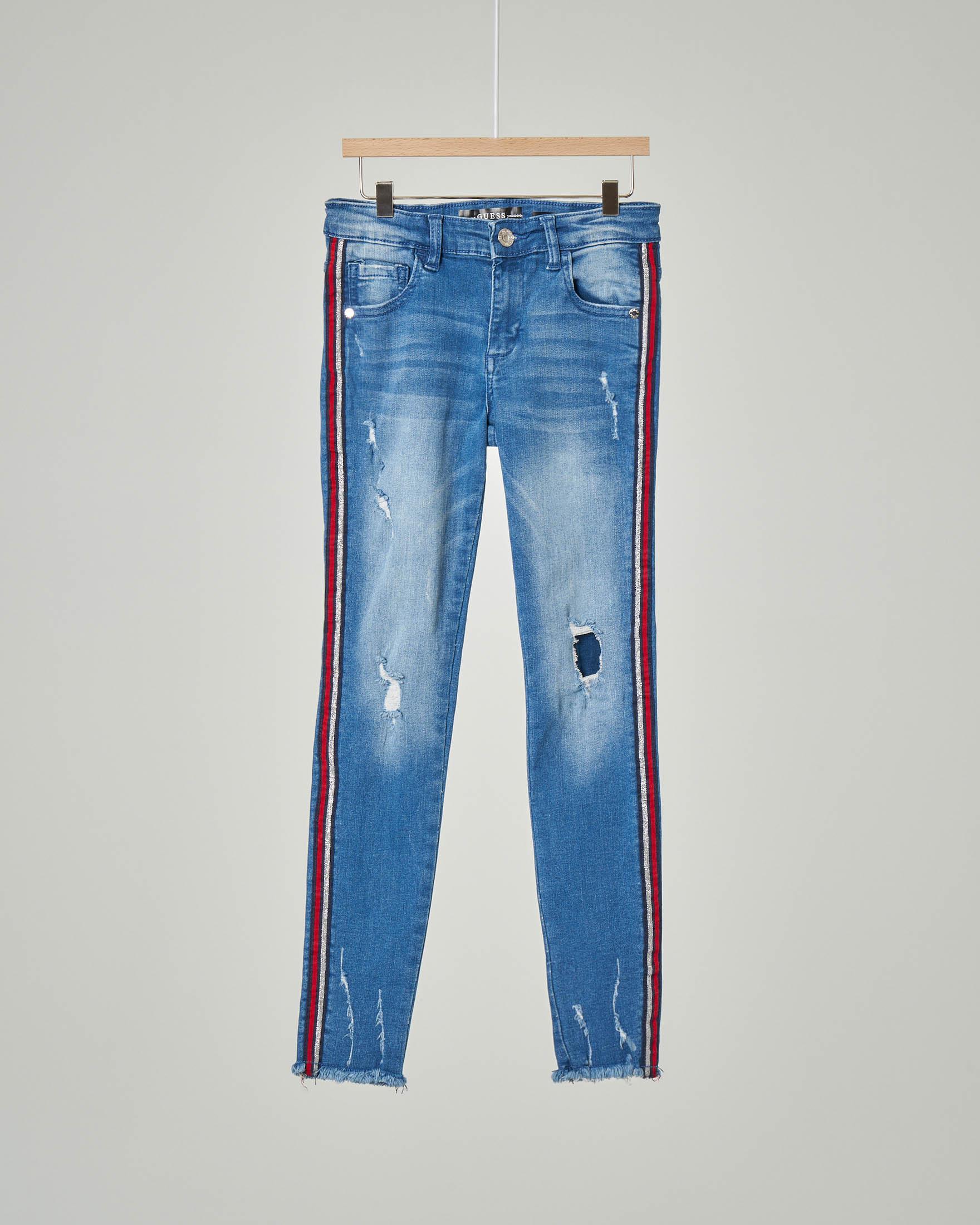 Jeans con fasce in lurex ai fianche e orlo sfrangiato 8-16 anni