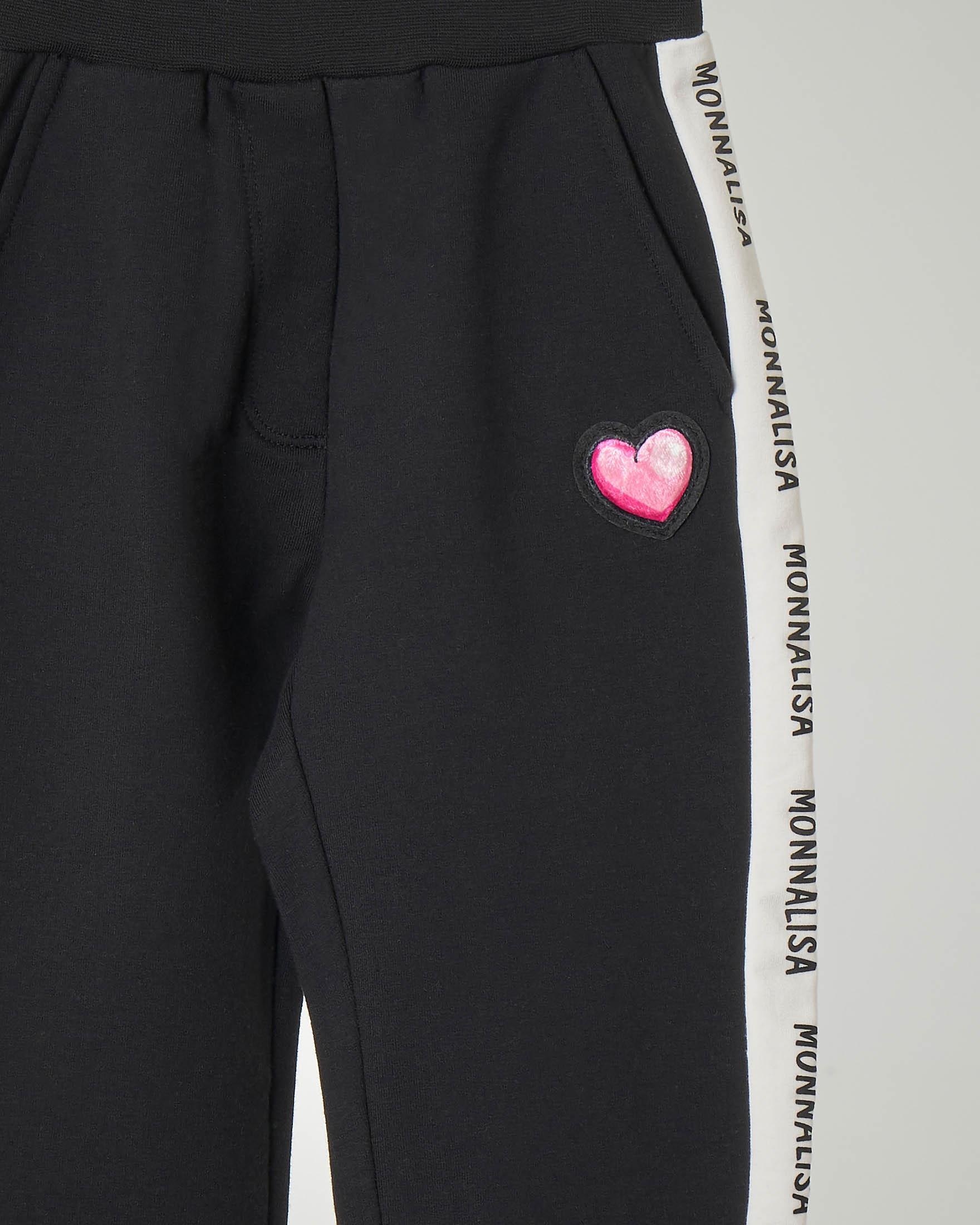 Pantaloni neri in jersey di cotone con bande ai lati a contrasto di colore con scritta logo 6-12 anni
