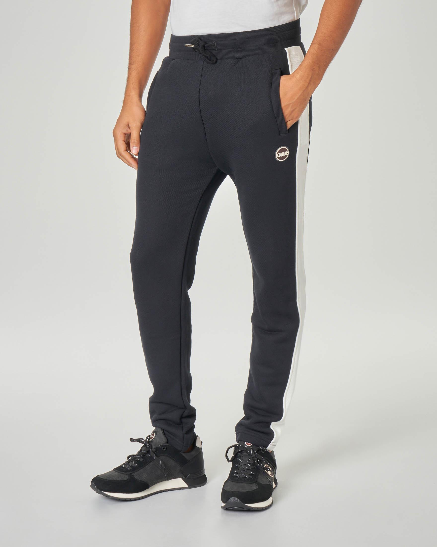 Pantalone nero in felpa garzata con bande a contrasto