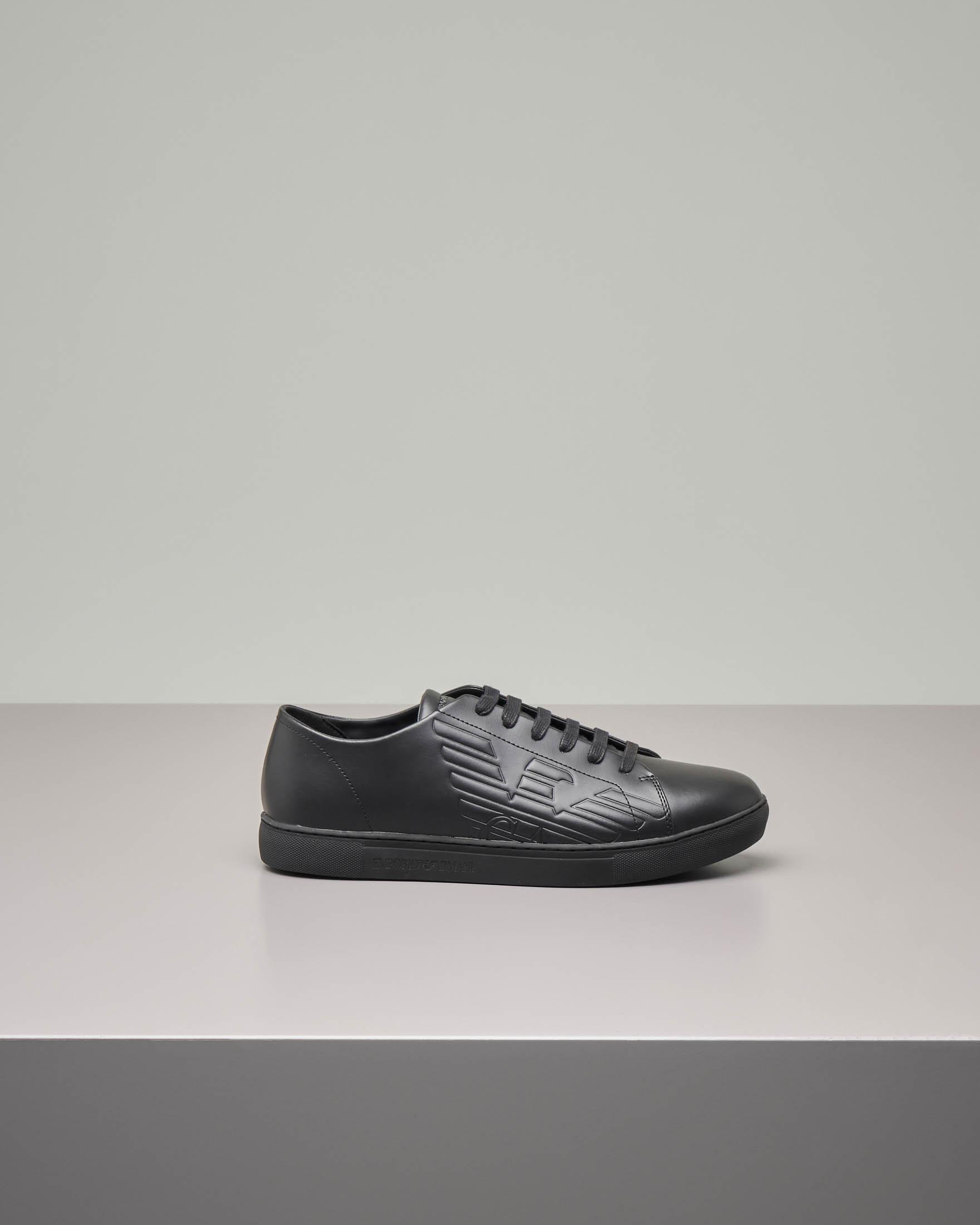Sneakers nere in pelle con logo aquila in rilievo