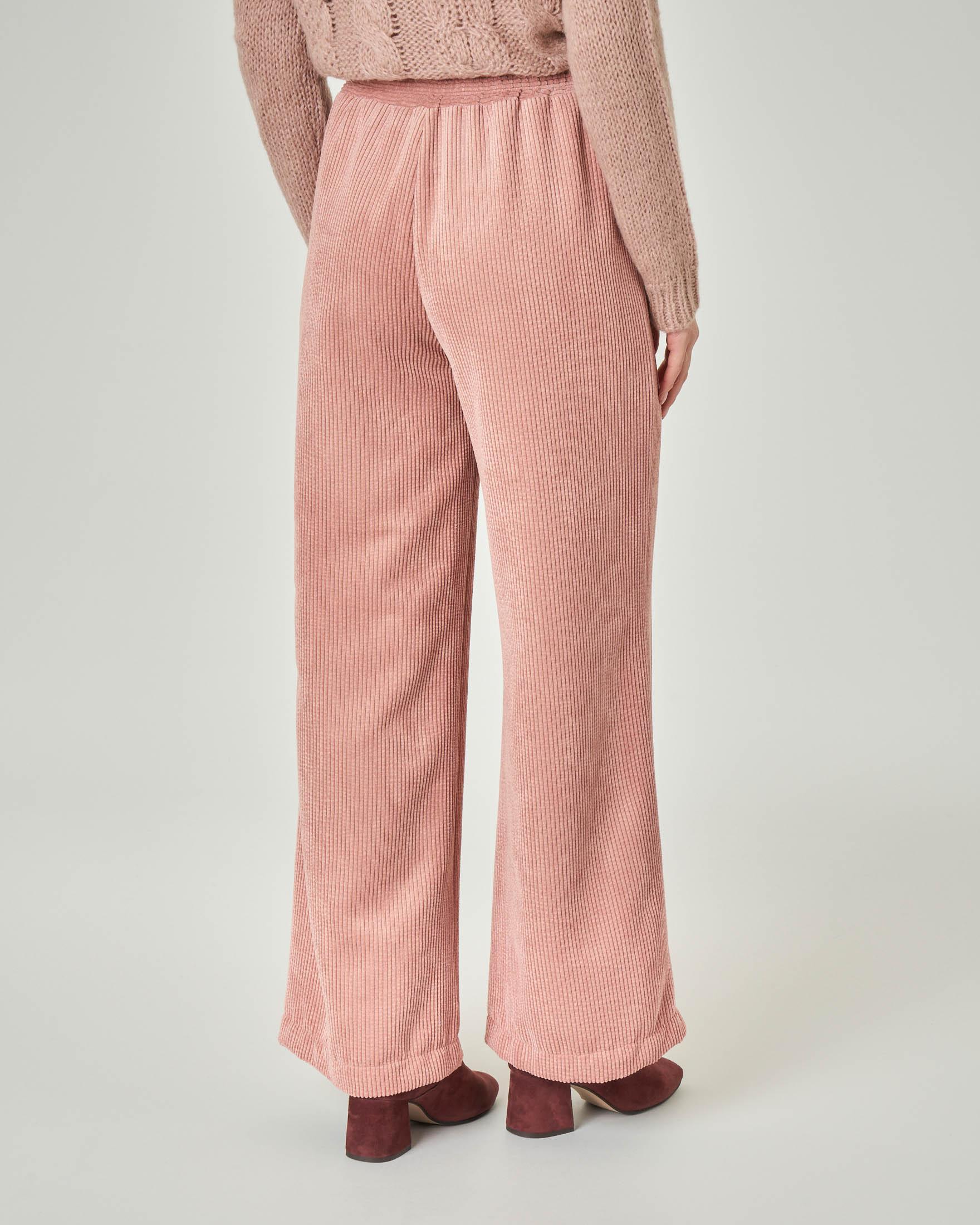 Pantaloni ampi in velluto a coste rosa con elastico inserito in vita