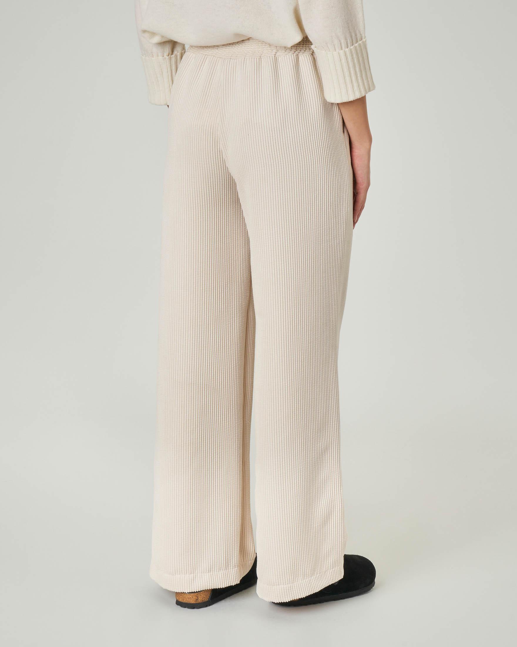 Pantaloni ampi in velluto a coste color avorio con elastico inserito in vita