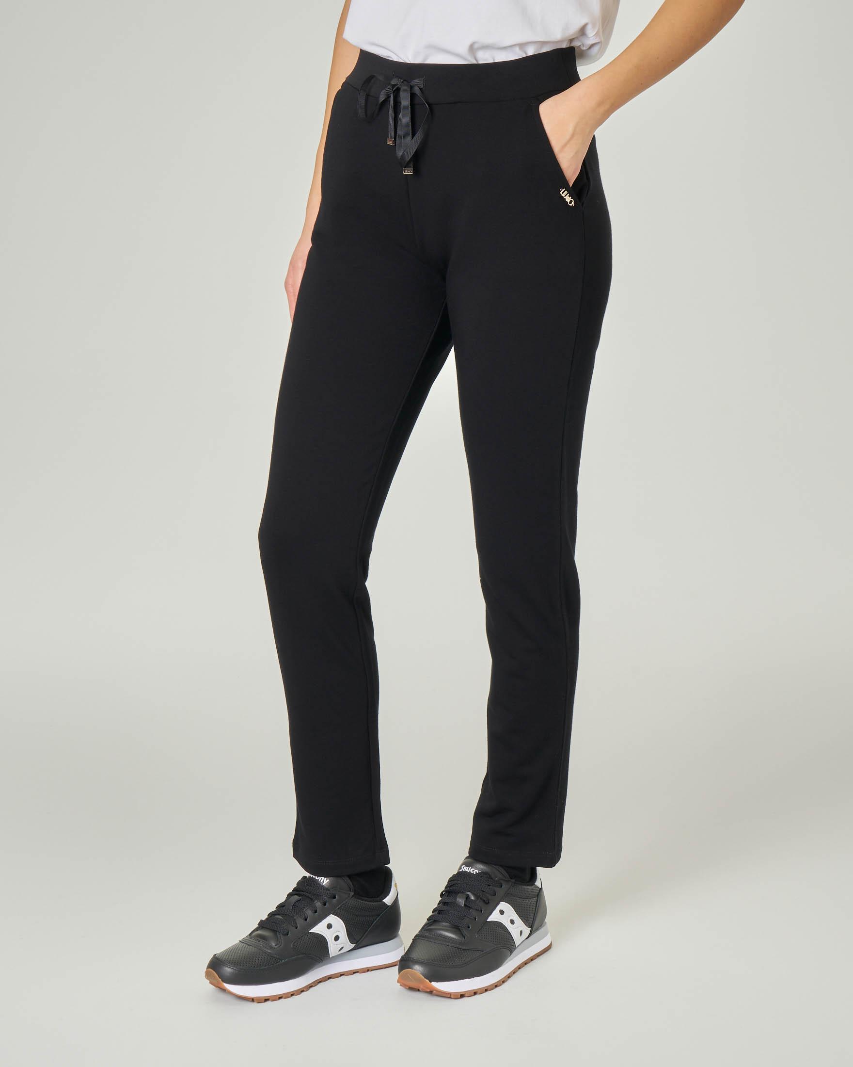 Pantaloni neri in viscosa elasticizzata con elastico e coulisse inserti in vita