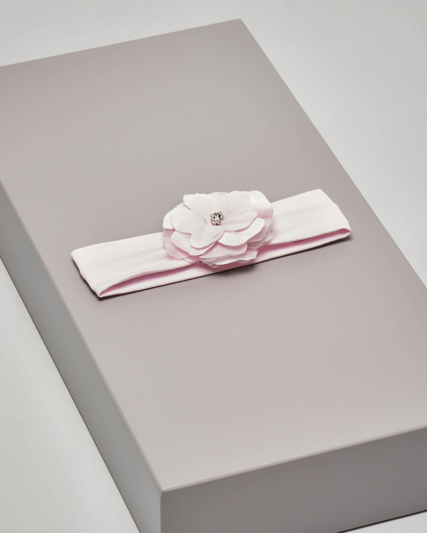 Fascia rosa in cotone elasticizzato con fiore e gioiello applicati