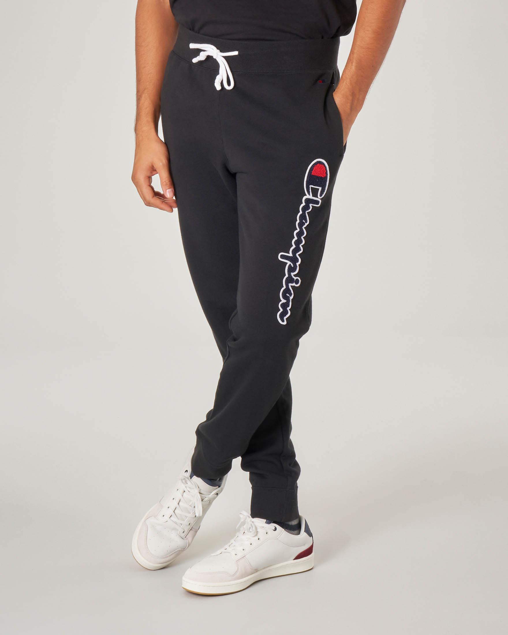 Pantalone nero in felpa con logo in spugna