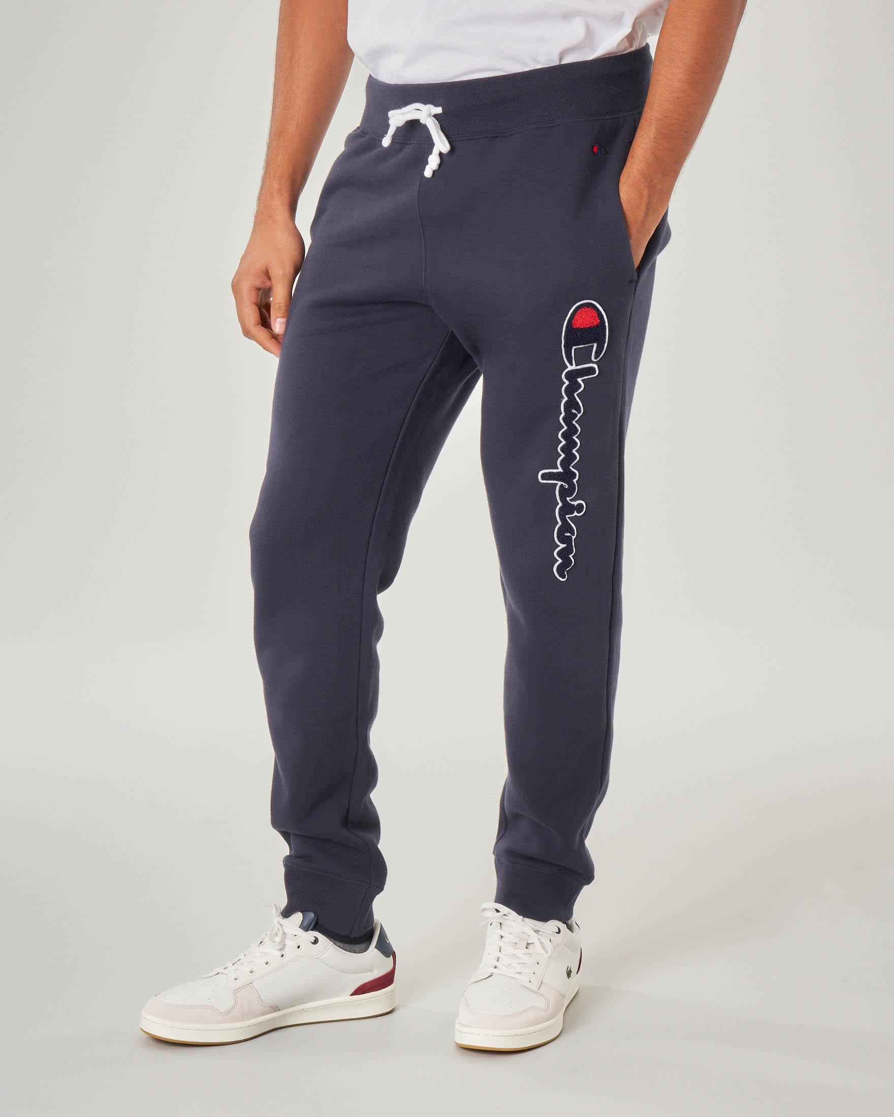 Pantalone blu in felpa con logo in spugna