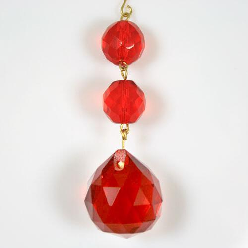 Strenna decorativa con perle sfaccettate rosse vetro cristallo molato.