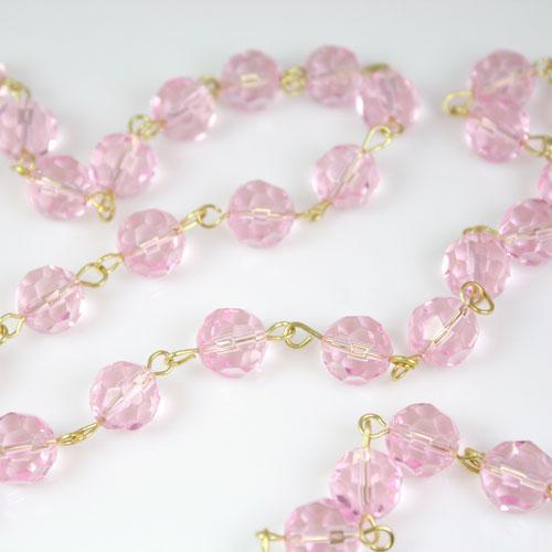 Catena 100 cm perle Ø 10 mm sfaccettate cristallo rosa, spillo a occhiello ottonato brillante.