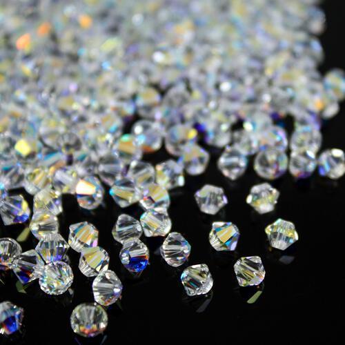 Perla bicono Aurora Boreale 4 mm cristallo Swarovski 5328 bead