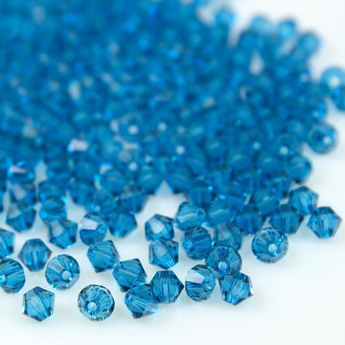 Perla bicono Indicolite 4 mm cristallo Swarovski 5328 bead