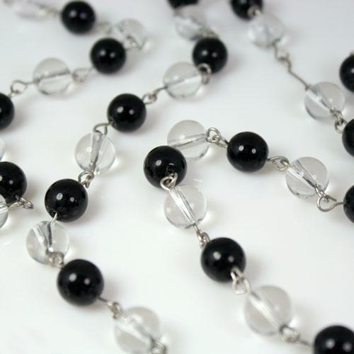 Catena 100 cm perle Ø10 mm, tondino liscio colore cristallo e nero, spillo a occhiello nickel